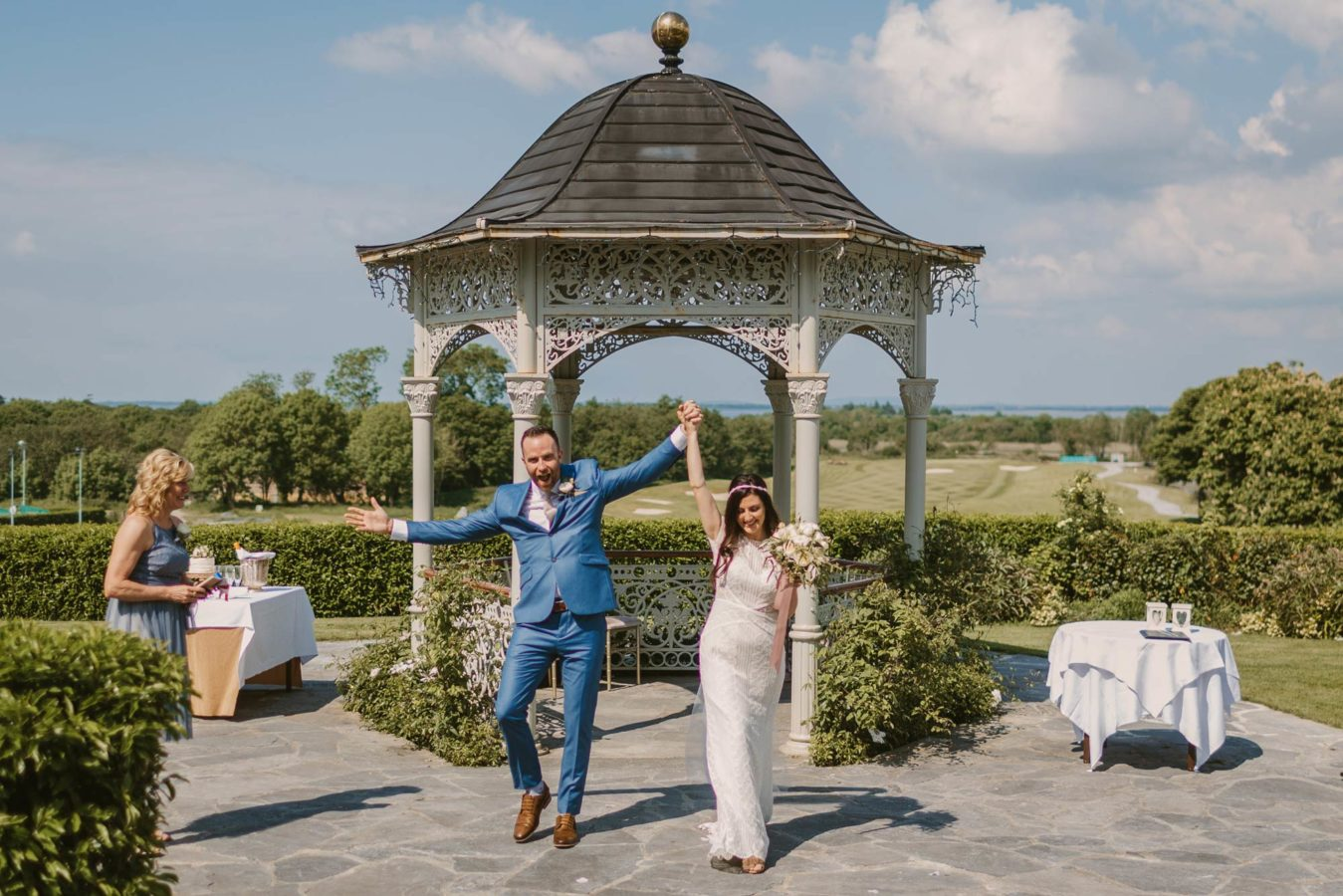 Elopement in galway city, a couple cheer with arms in the air, organized but their wedding planner Ireland