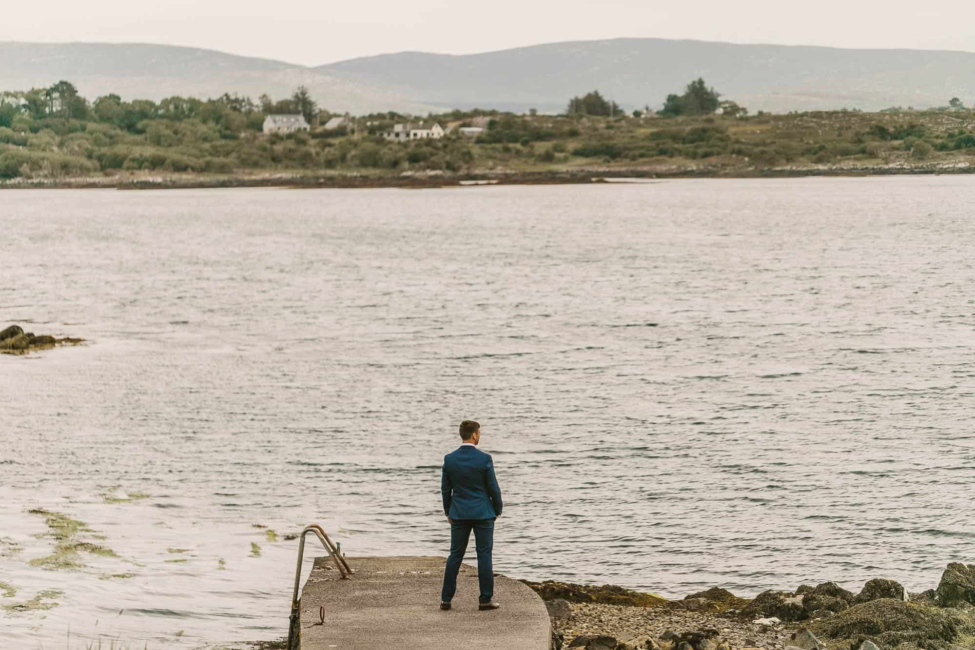 Elopement Ireland Connemara First look Waiting groom on the pier
