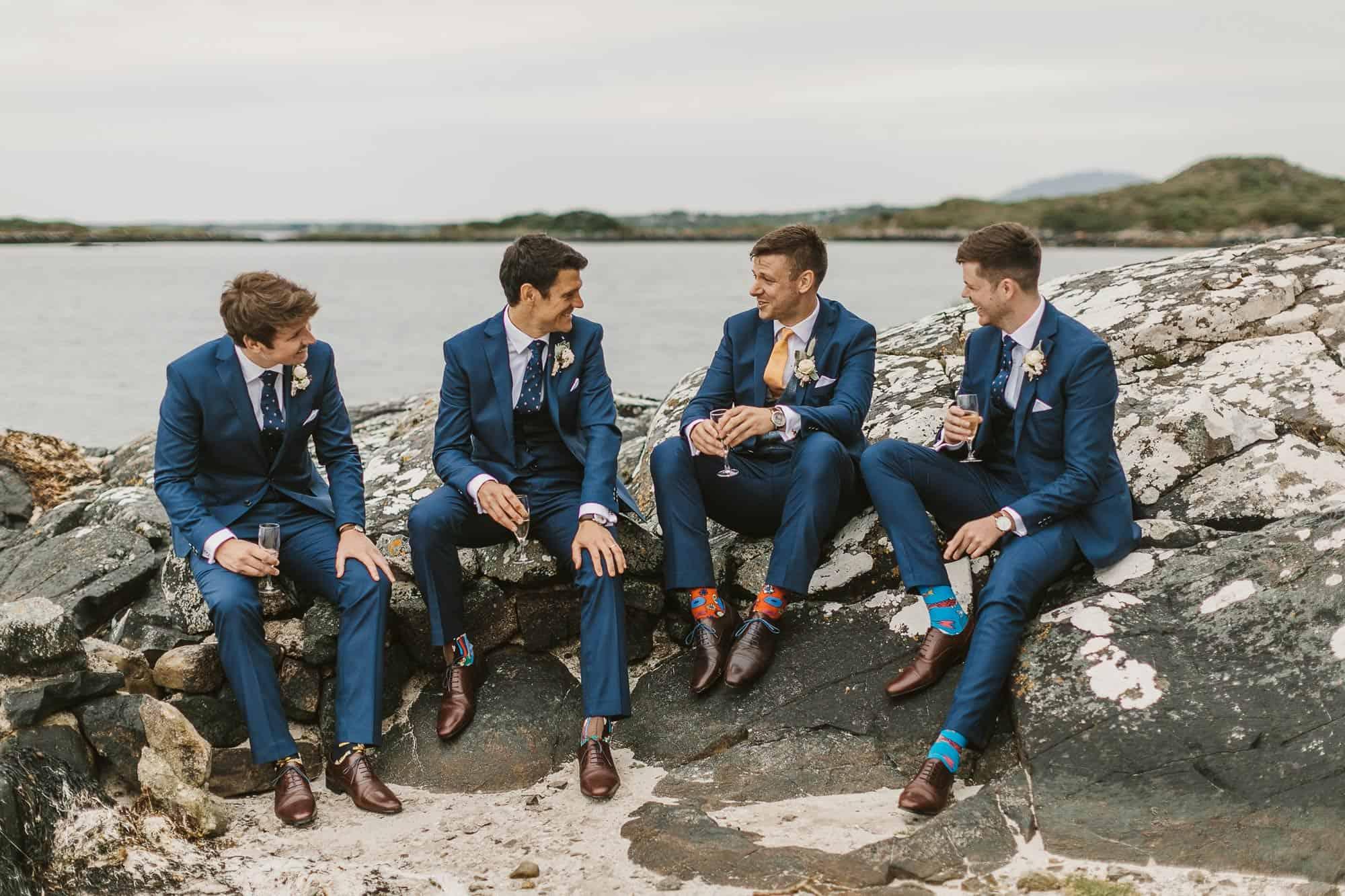 Elopement Ireland Connemara Having Fun with the boys, groomsmen are chatting on the rocks