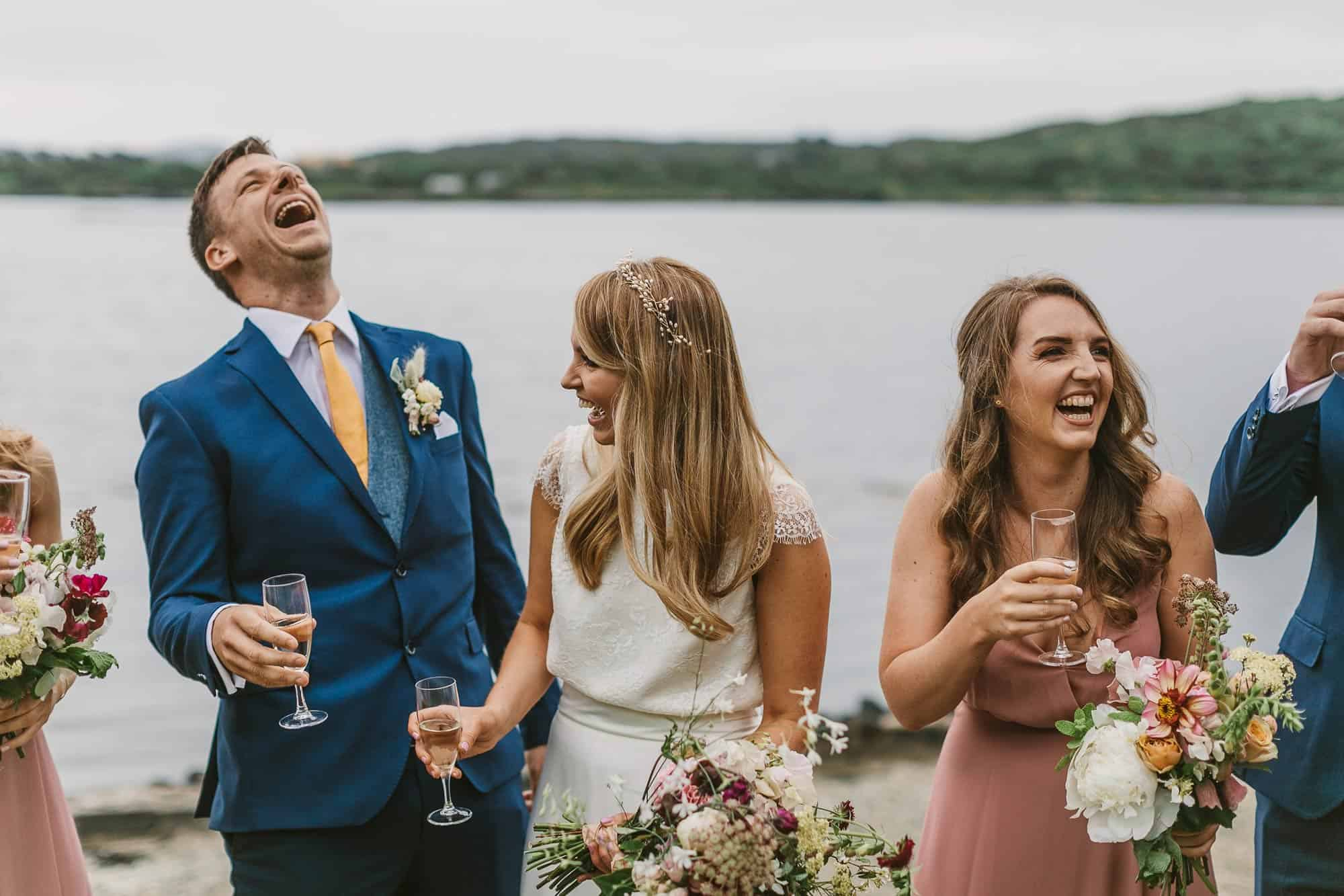 Elopement Ireland Connemara Laugher and Love with champagne on the beach