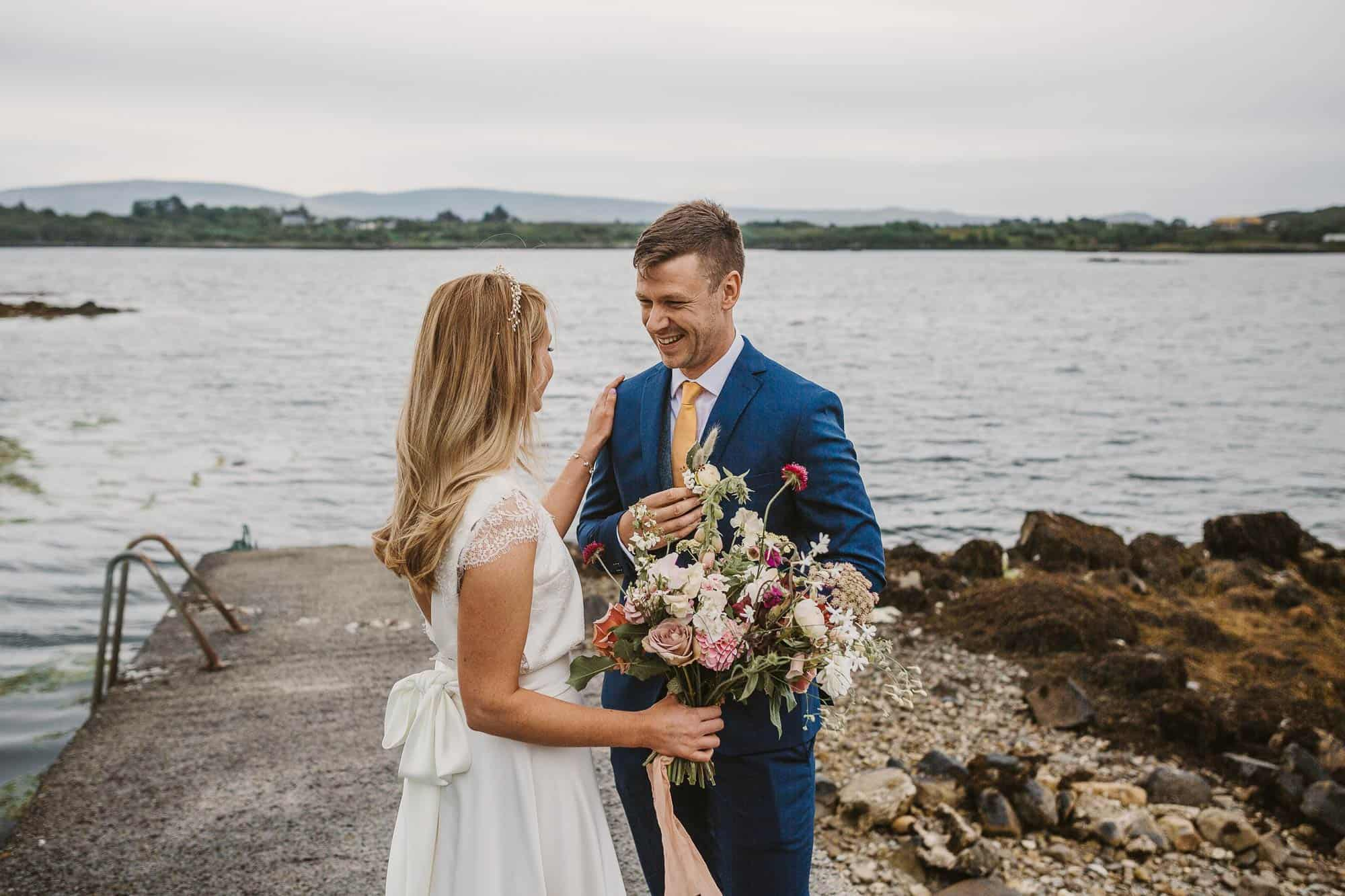 Elopement Ireland Connemara Ireland Wildflower Bouquet, couple on the pier