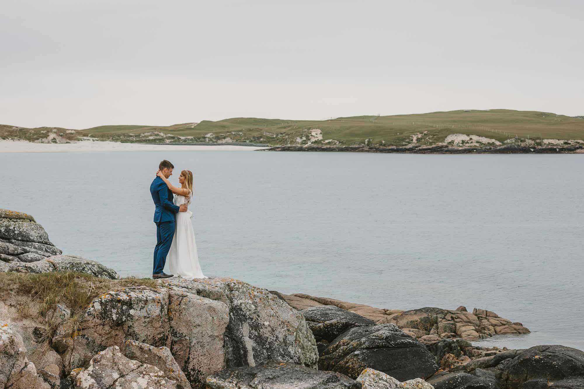 Elopement Ireland Connemara Beach Shoot of couple on rocks