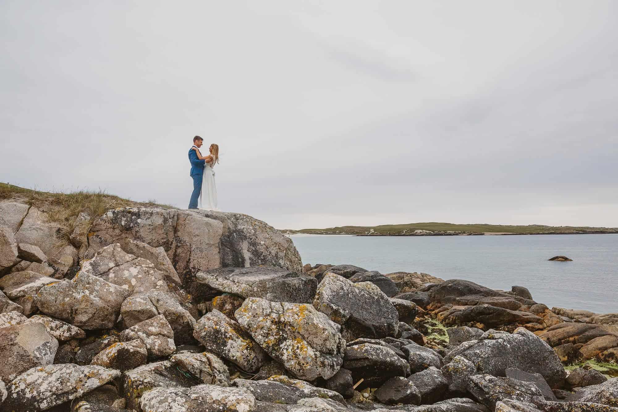 Elopement Ireland Connemara couple on the Beach on the Rocks