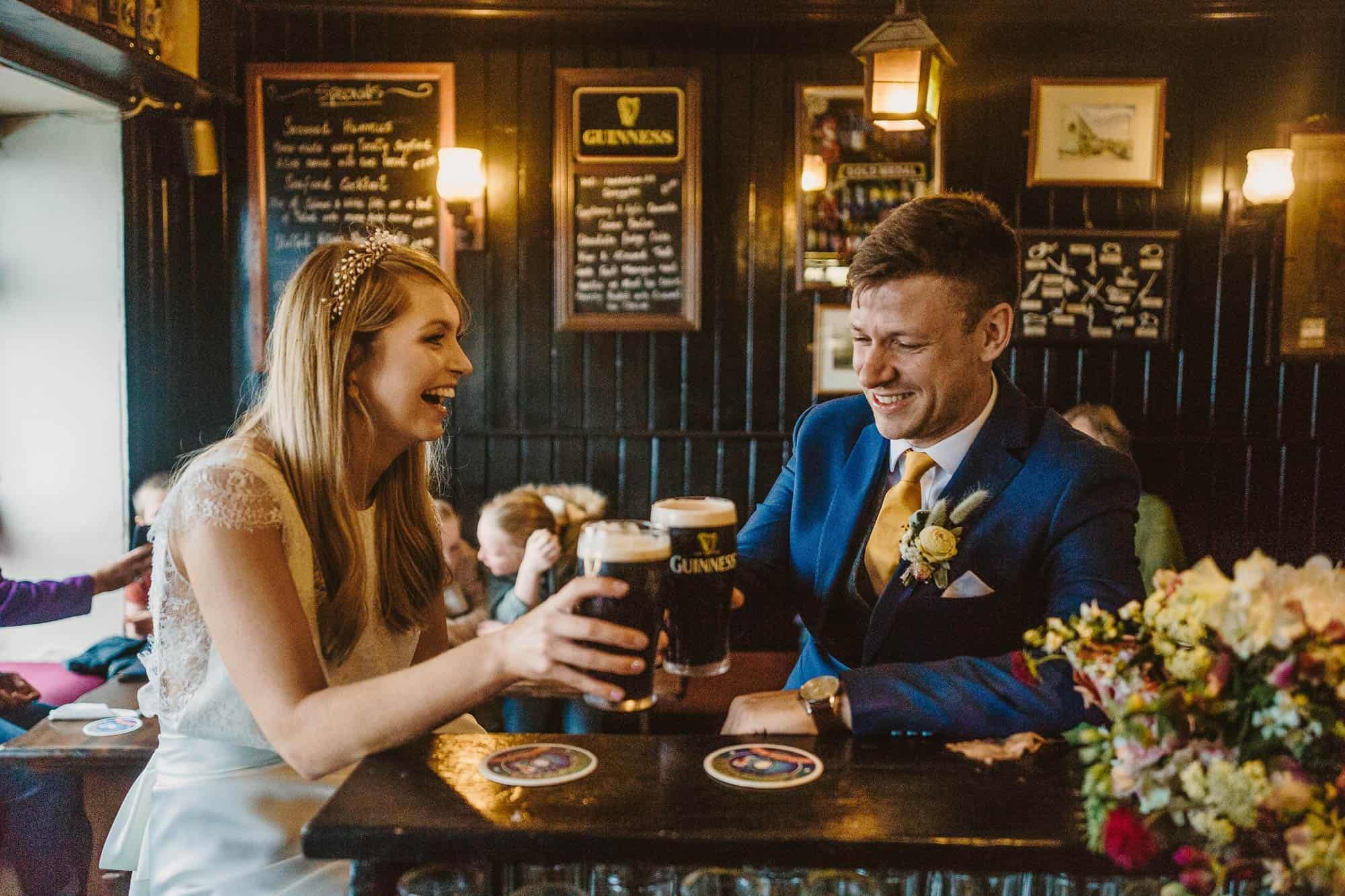 Elopement Ireland Connemara couple have a Guinness in an Irish Pub