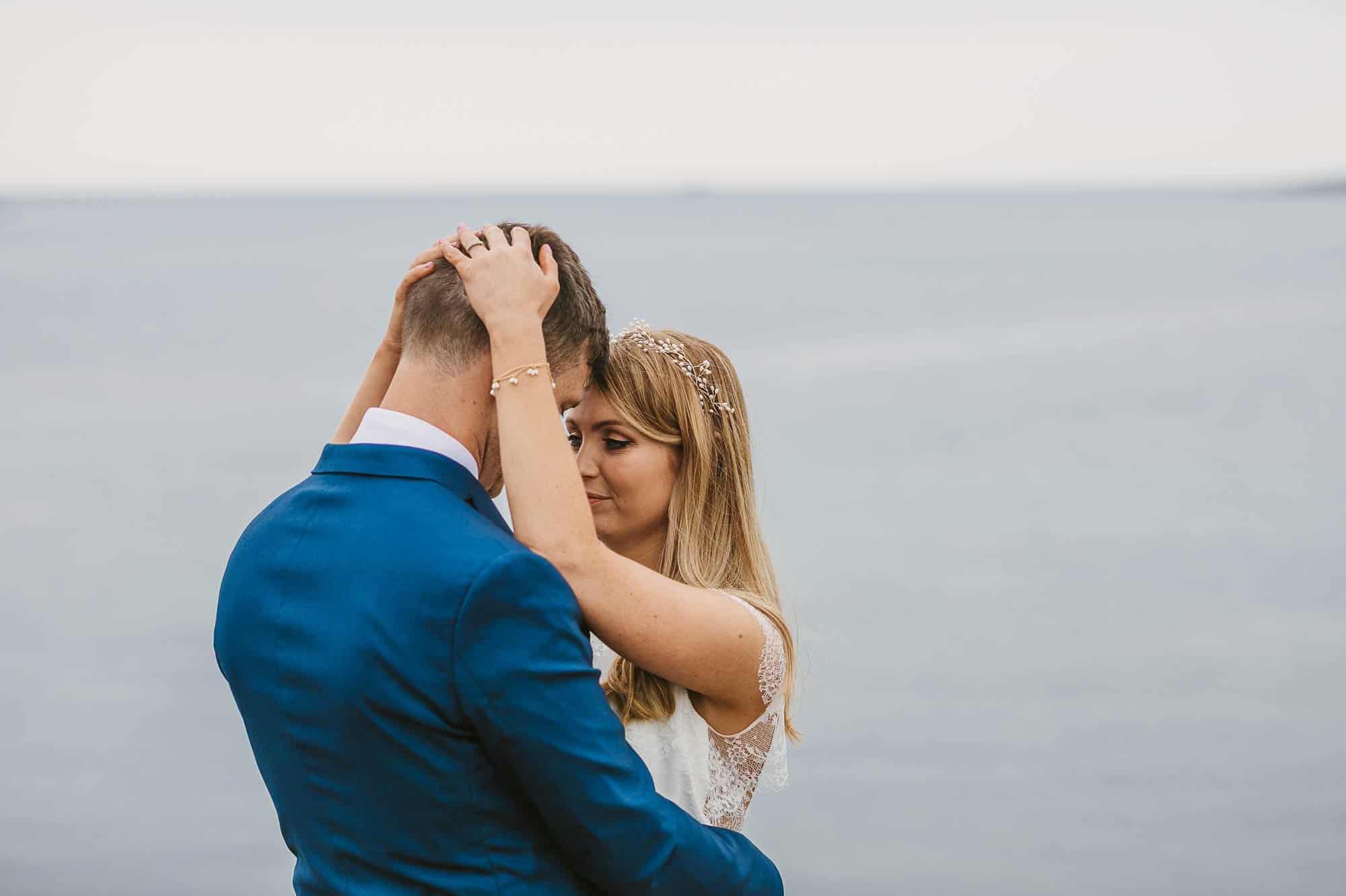 Elopement Ireland Connemara couple embrace on the coast