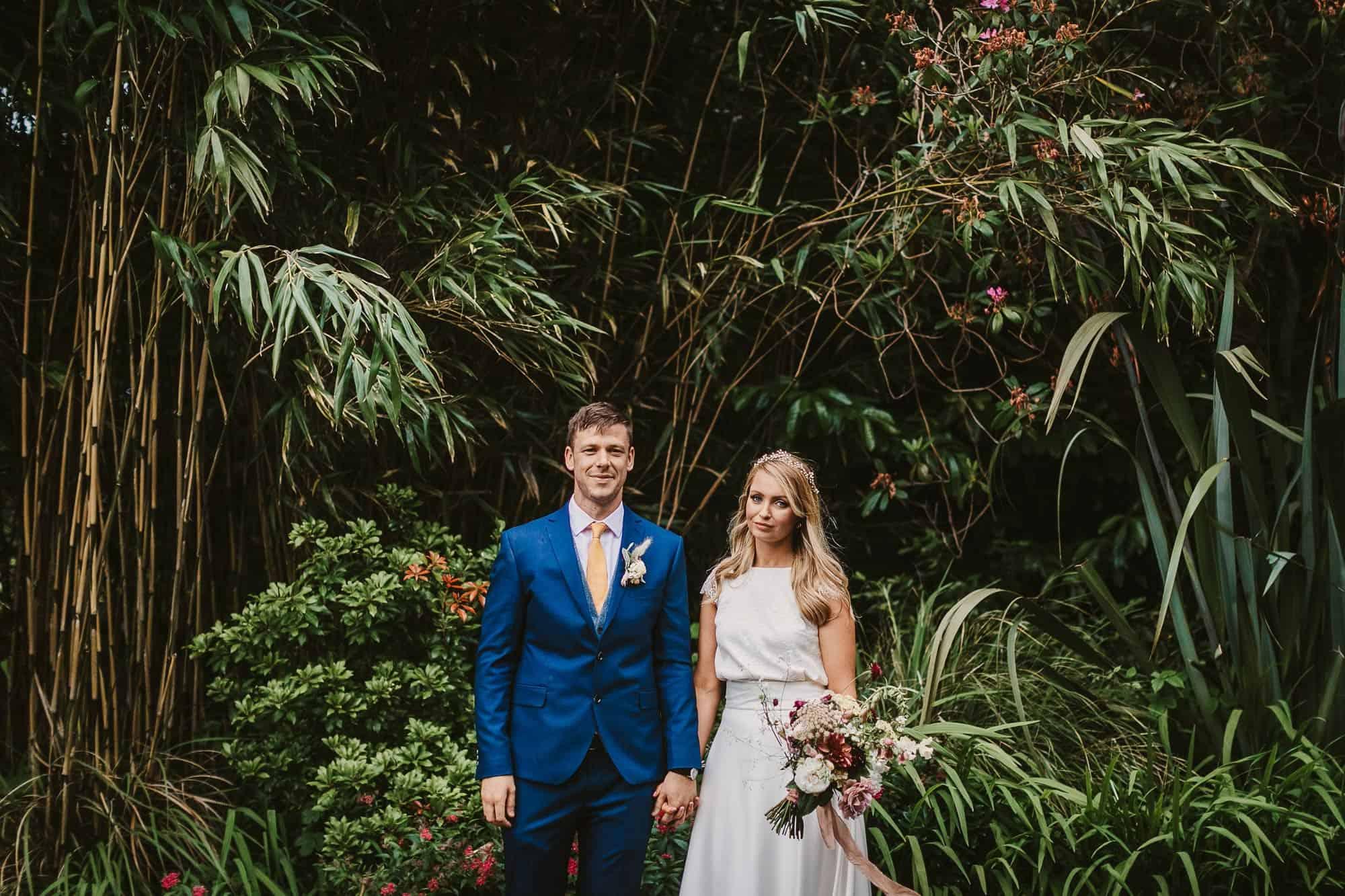 Elopement Ireland Connemara Nature Shoot, couple hold hands under trees