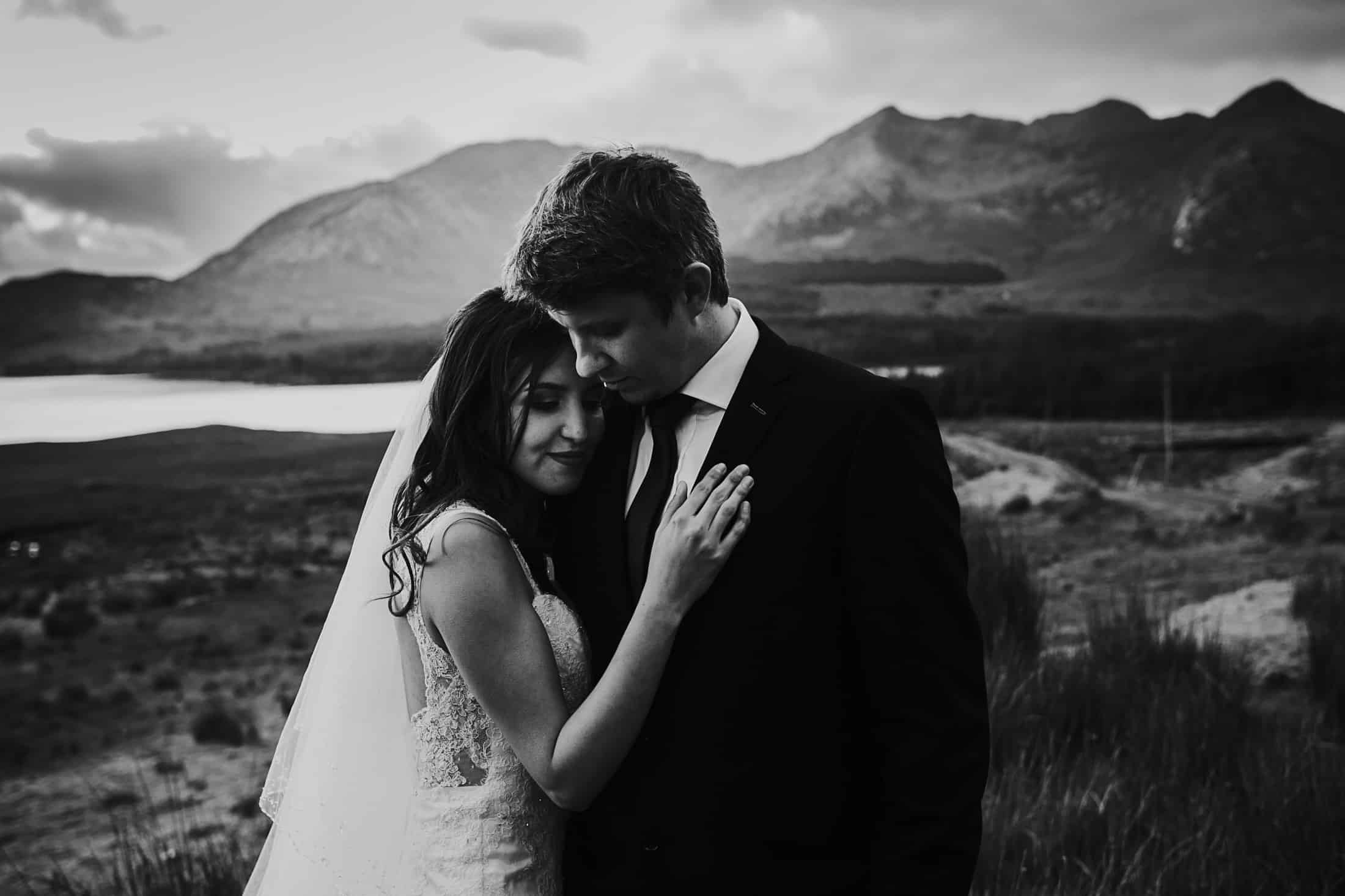 Destination Weddings Ireland Connemara, a couple elope to Ireland. The One. A couple hold on to each other on their Ireland Elopement