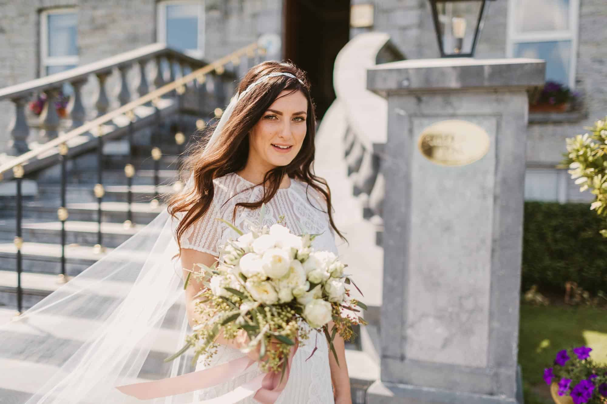 Elopement videographer Ireland, bride with bouquet