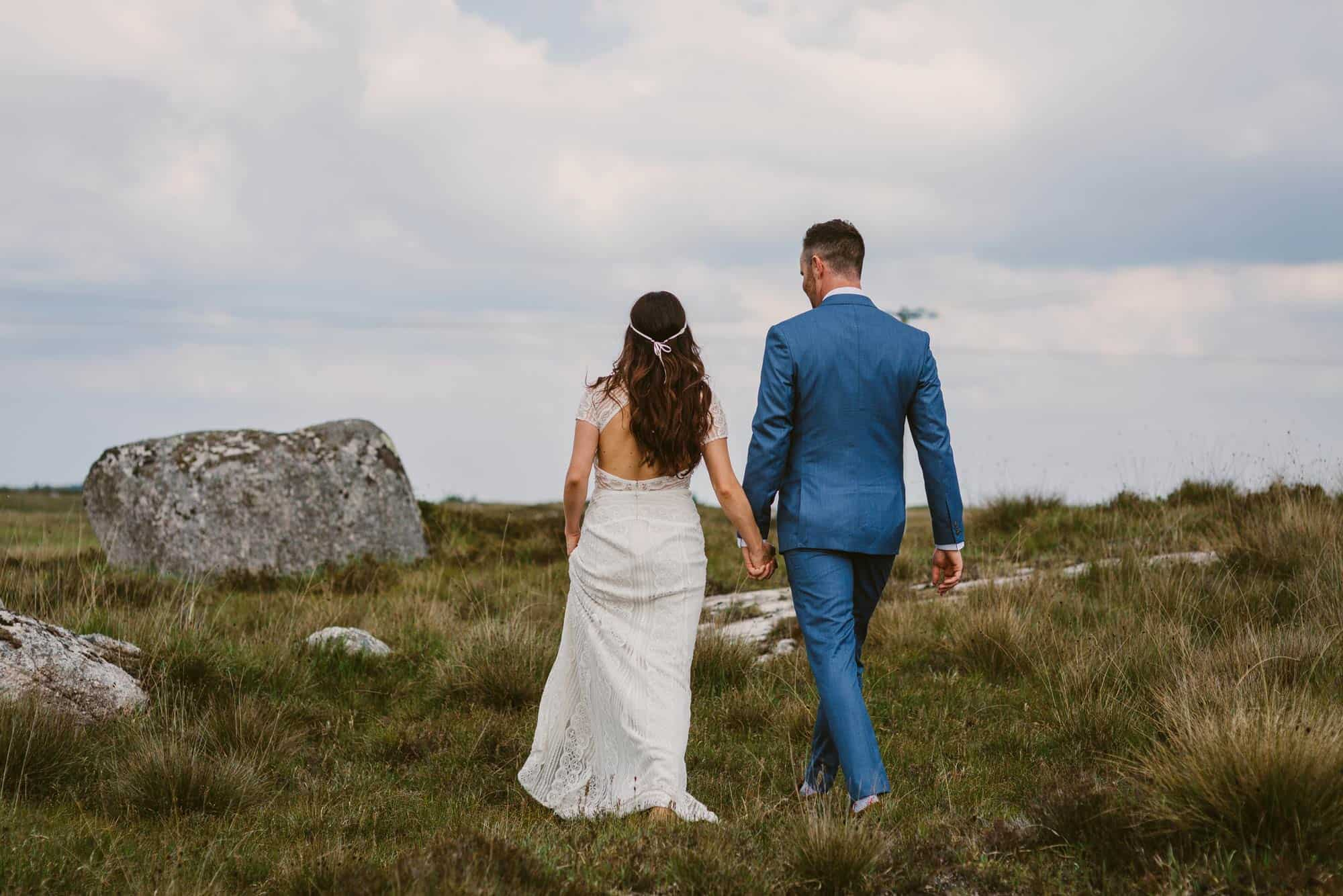 Elopement videographer Ireland, couple wandering in fields