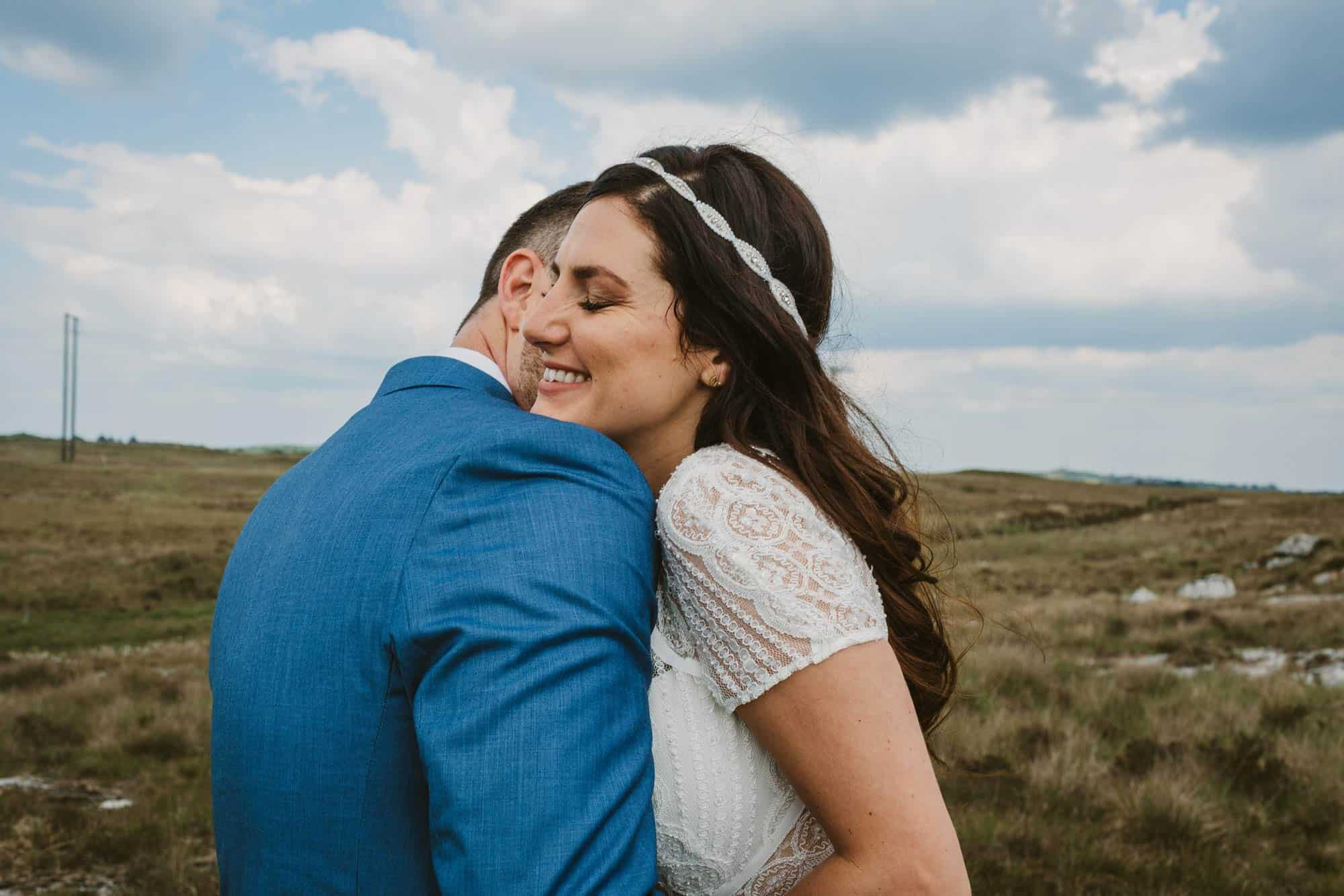 Elopement videographer Ireland, couple hugging