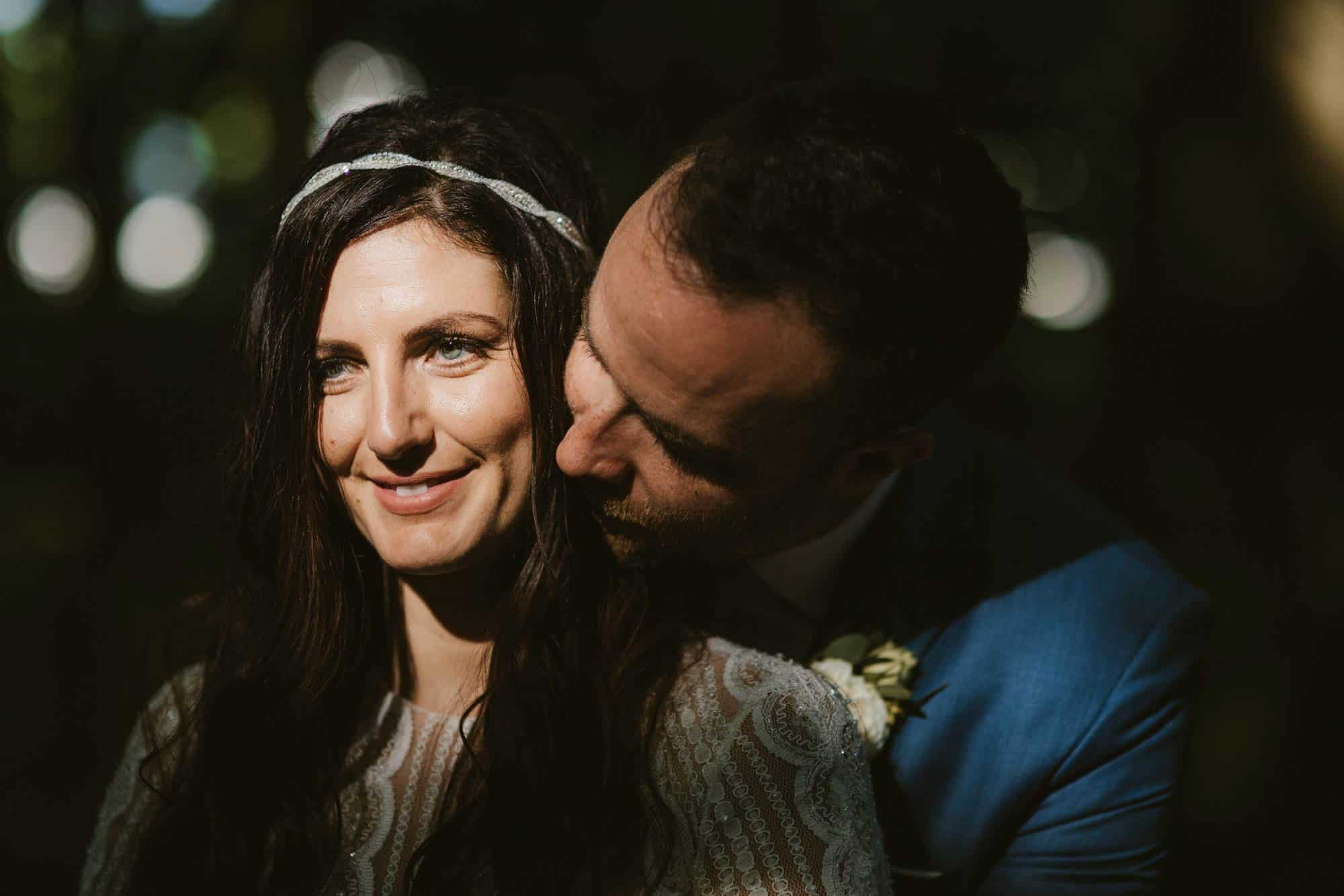 Elopement videographer Ireland, smiling bride in dark light