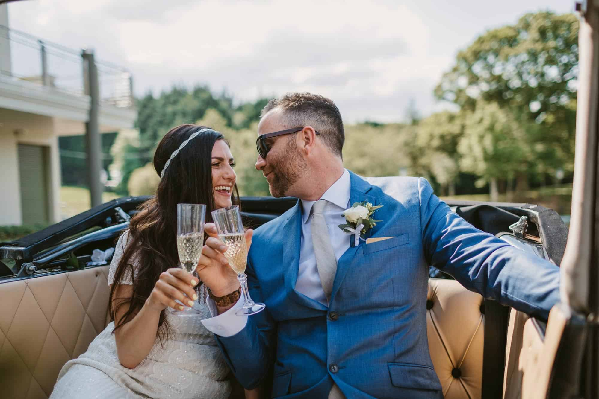 Elopement videographer Ireland, couple drinking champagne