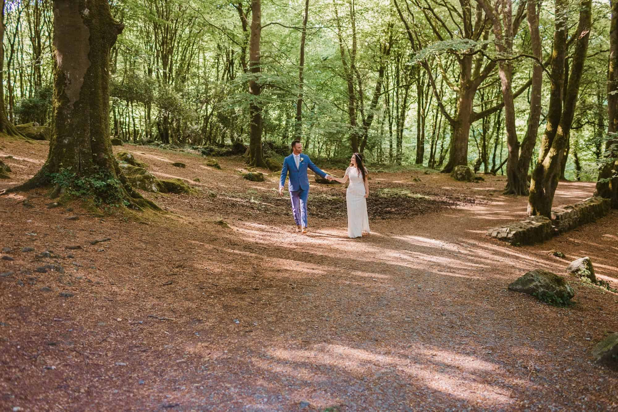Elopement videographer Ireland, couple walk through forest
