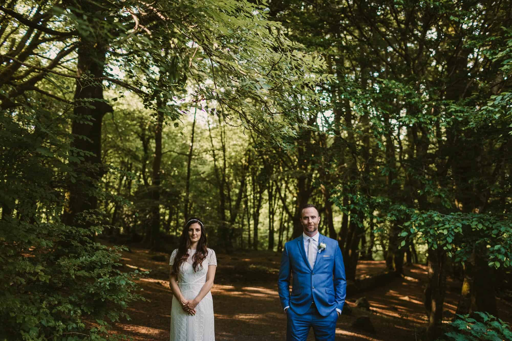 Elopement videographer Ireland, couple in forest posing