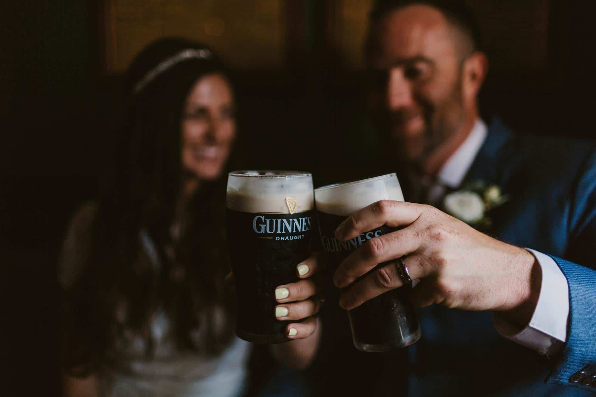 Elopement videographer Ireland, couple drinking Guinness