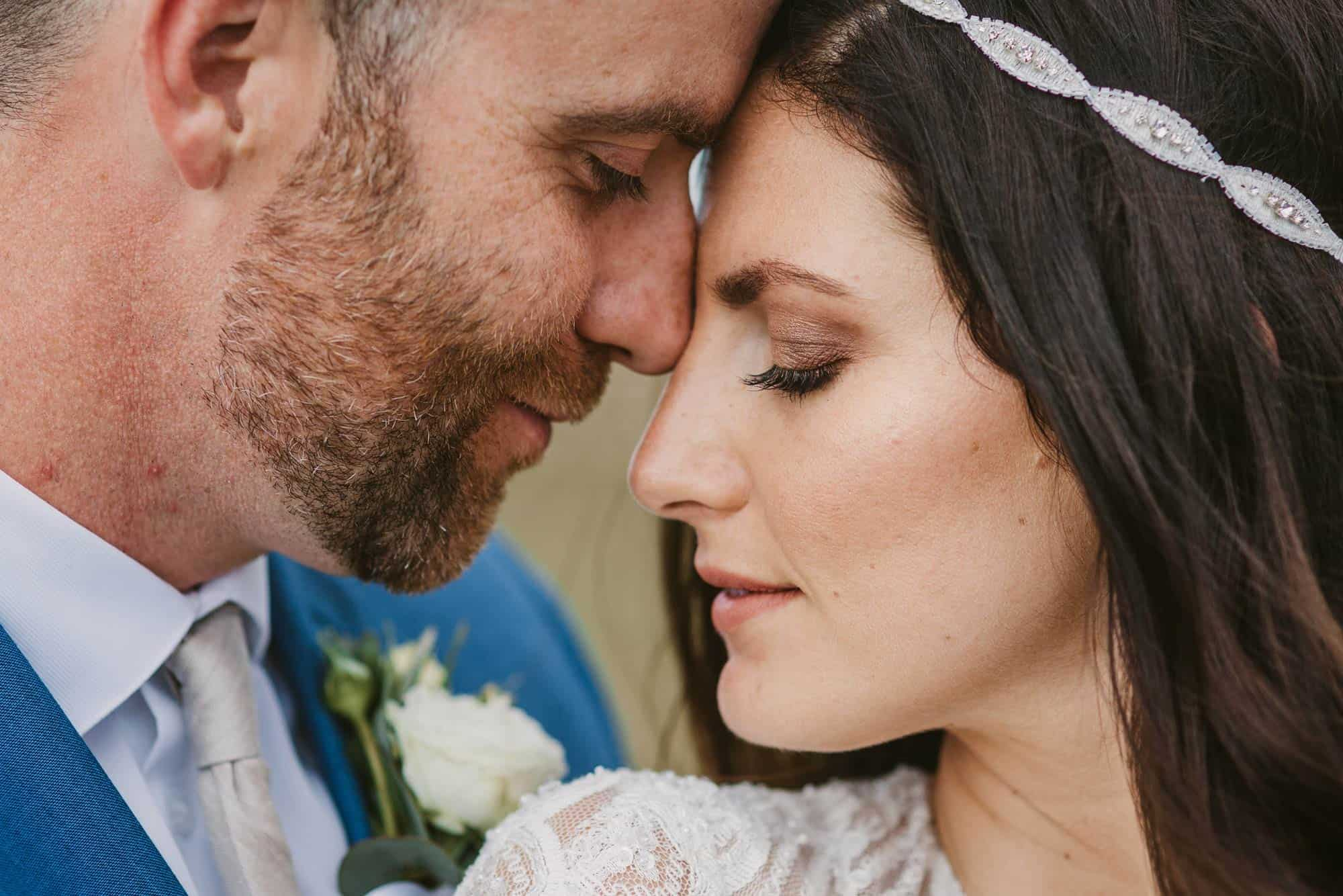 Elopement videographer Ireland, couple touching foreheads