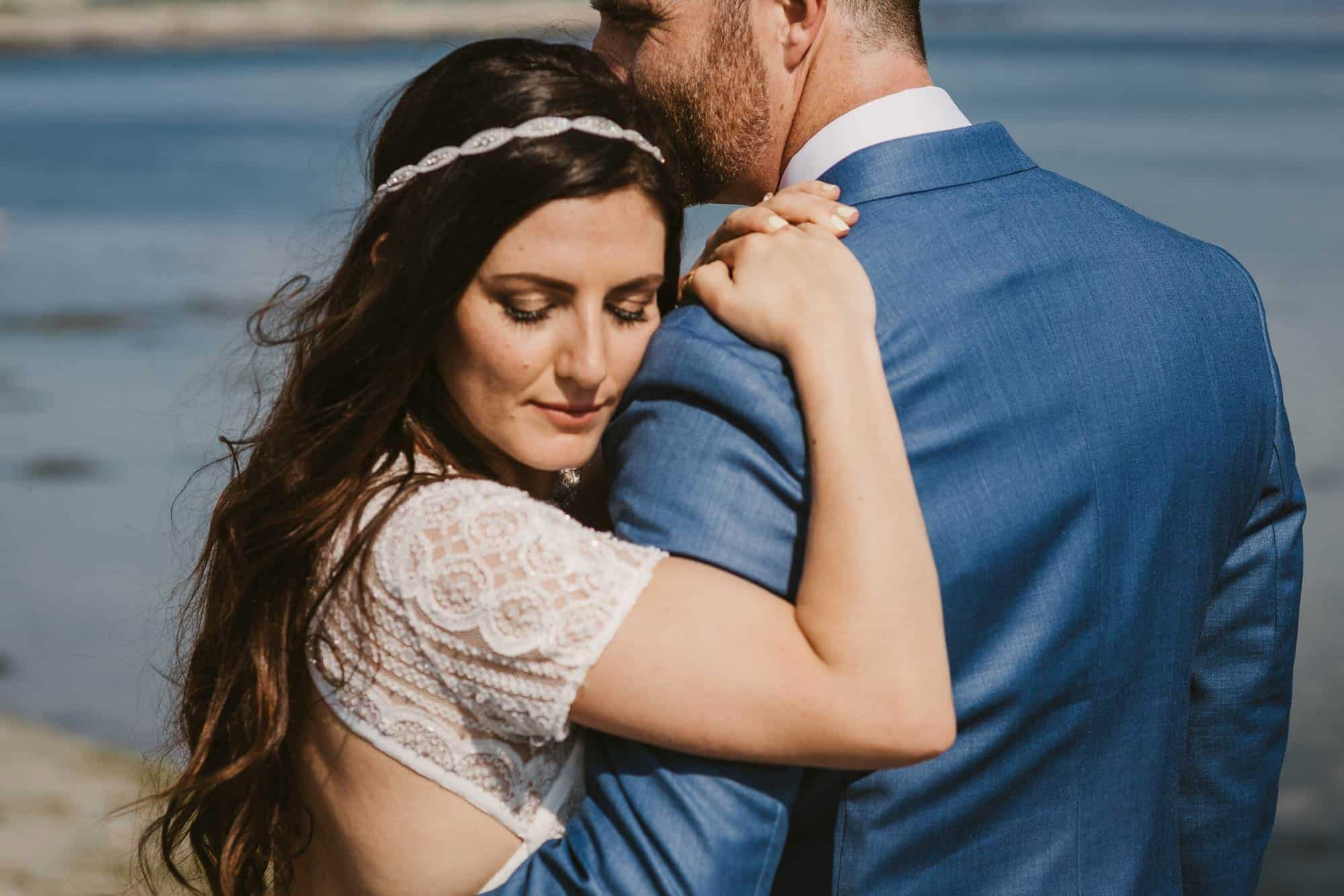 Elopement videographer Ireland, bride leans on grooms shoulder