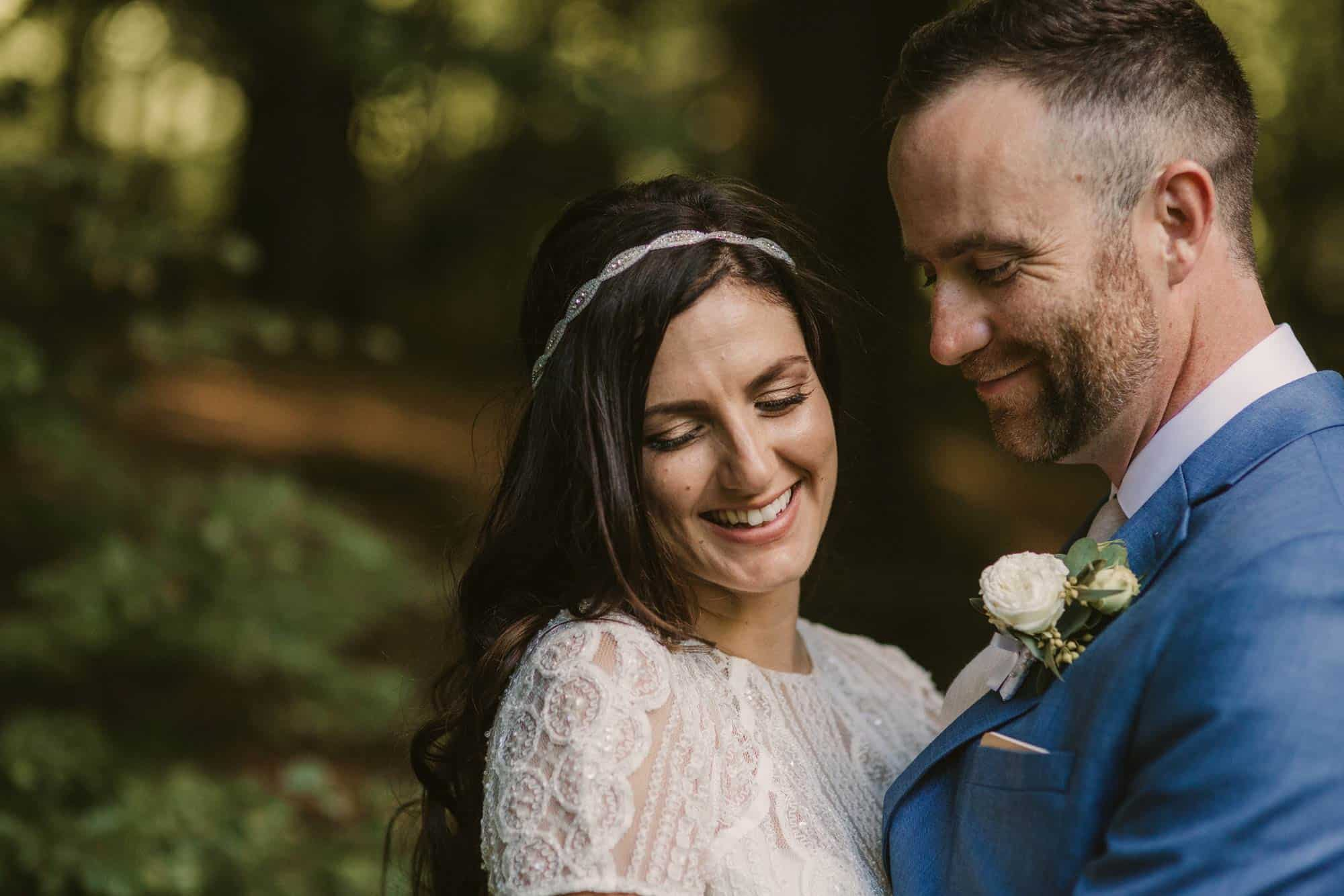 Elopement videographer Ireland, couple smiling in forest