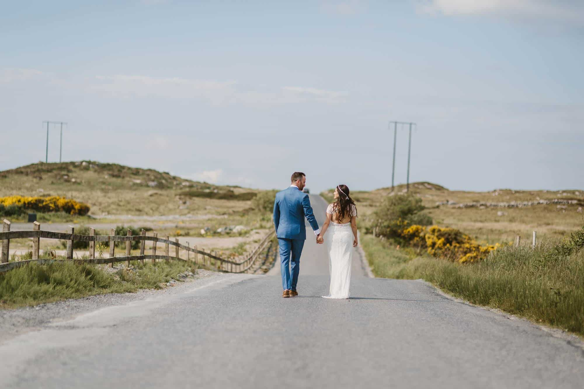 Elopement videographer Ireland, couple walking on a country road