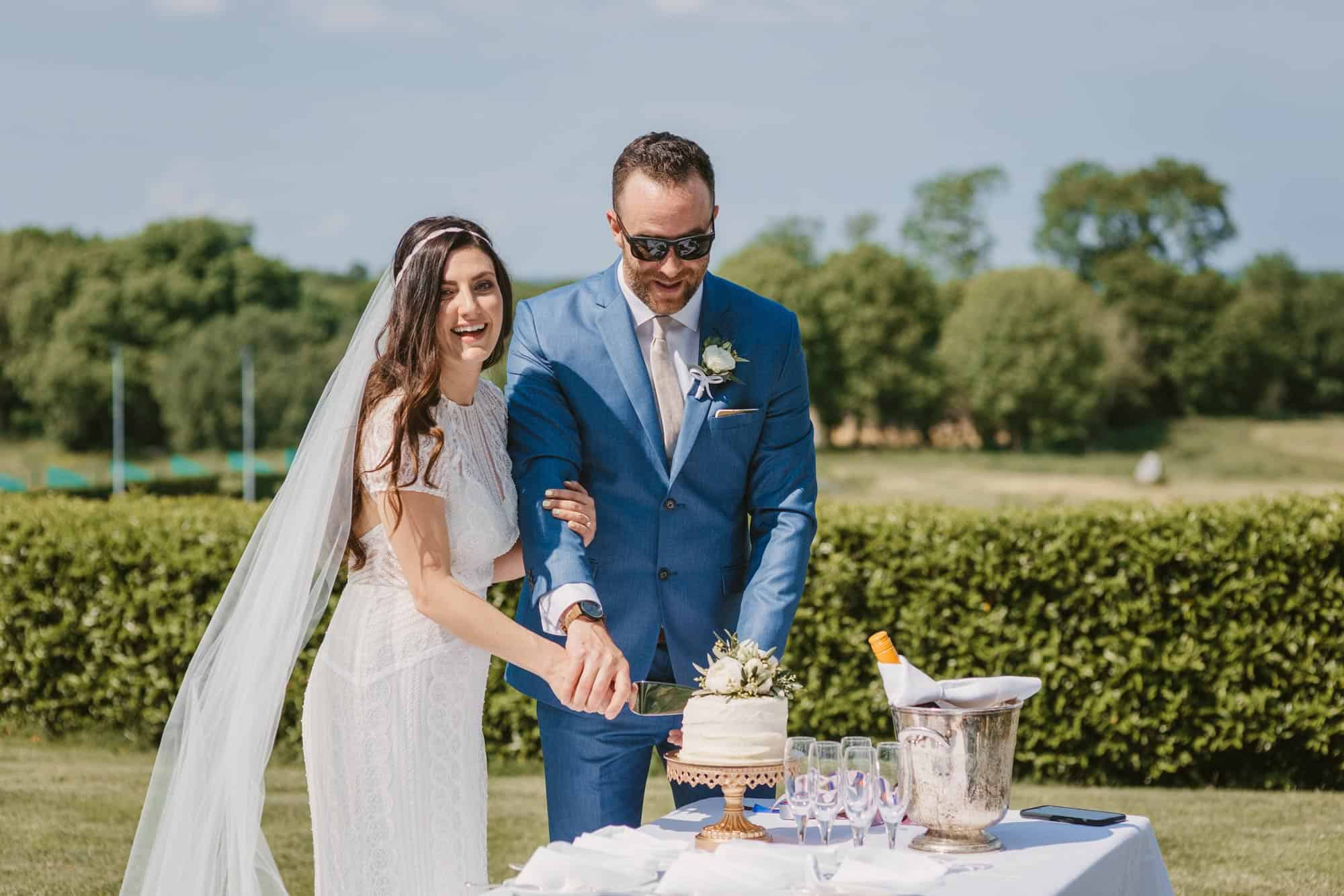 Elopement videographer Ireland, couple cut their wedding cake