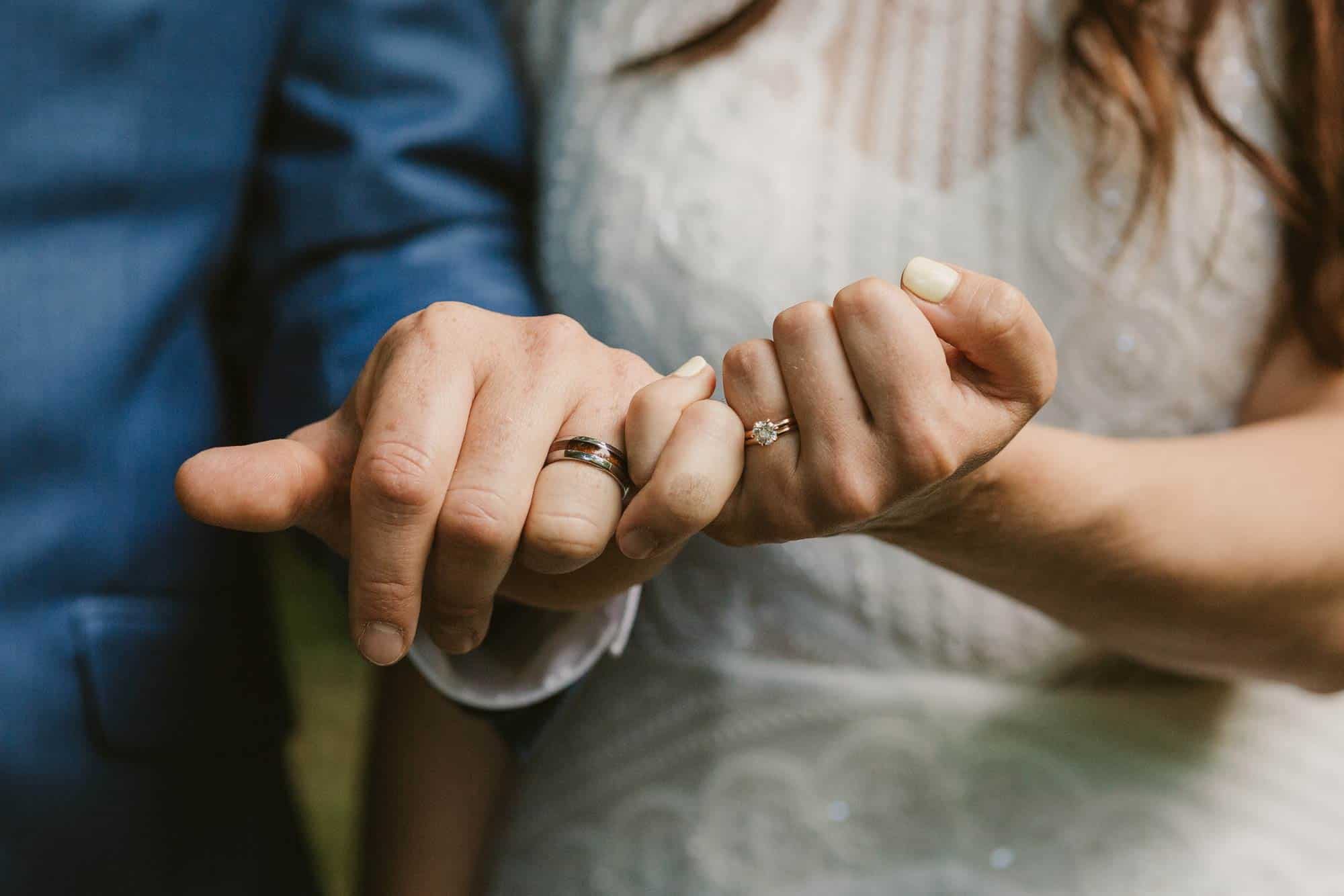 Elopement videographer Ireland, couple hands with wedding rings on
