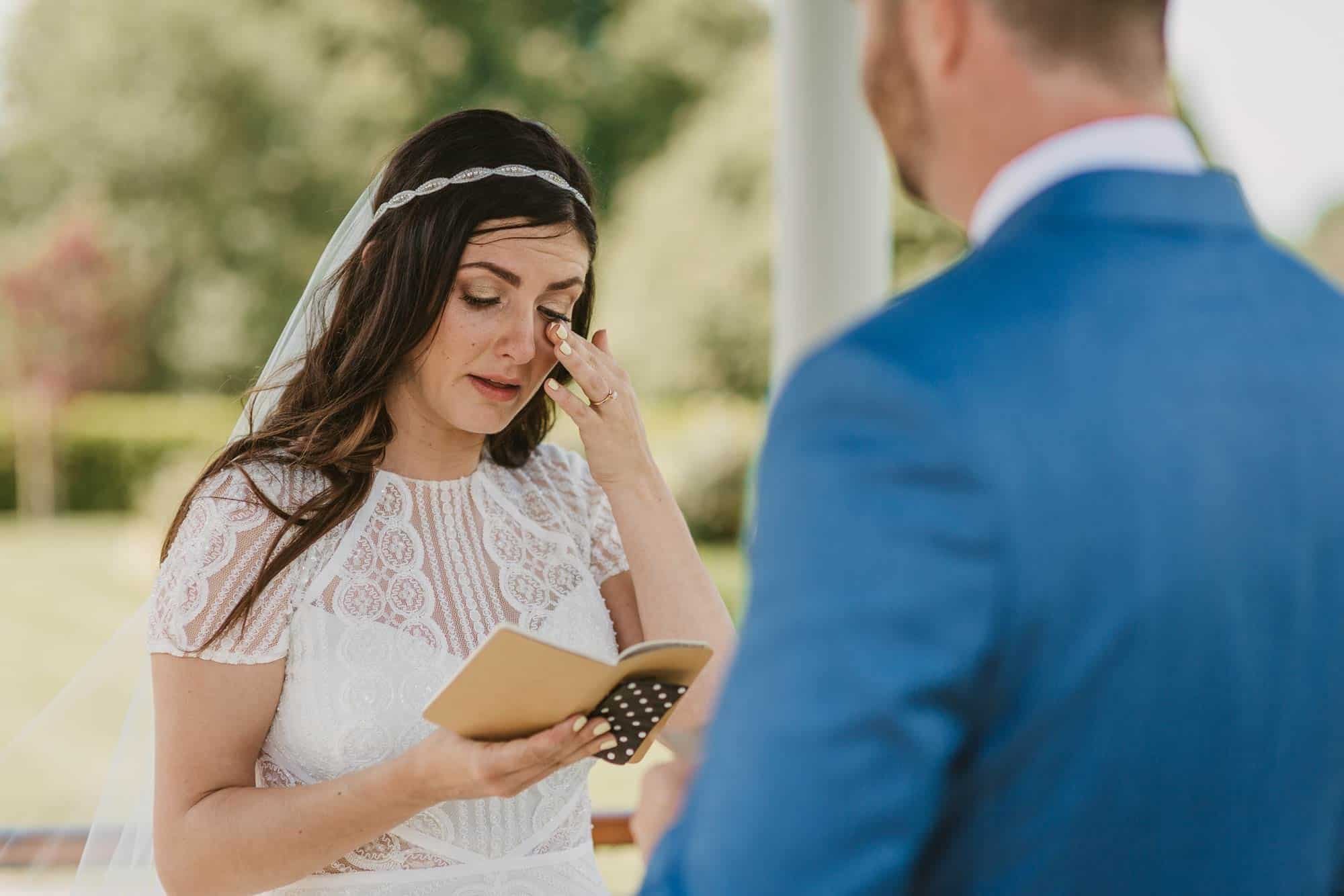Elopement videographer Ireland, bride reading her vows