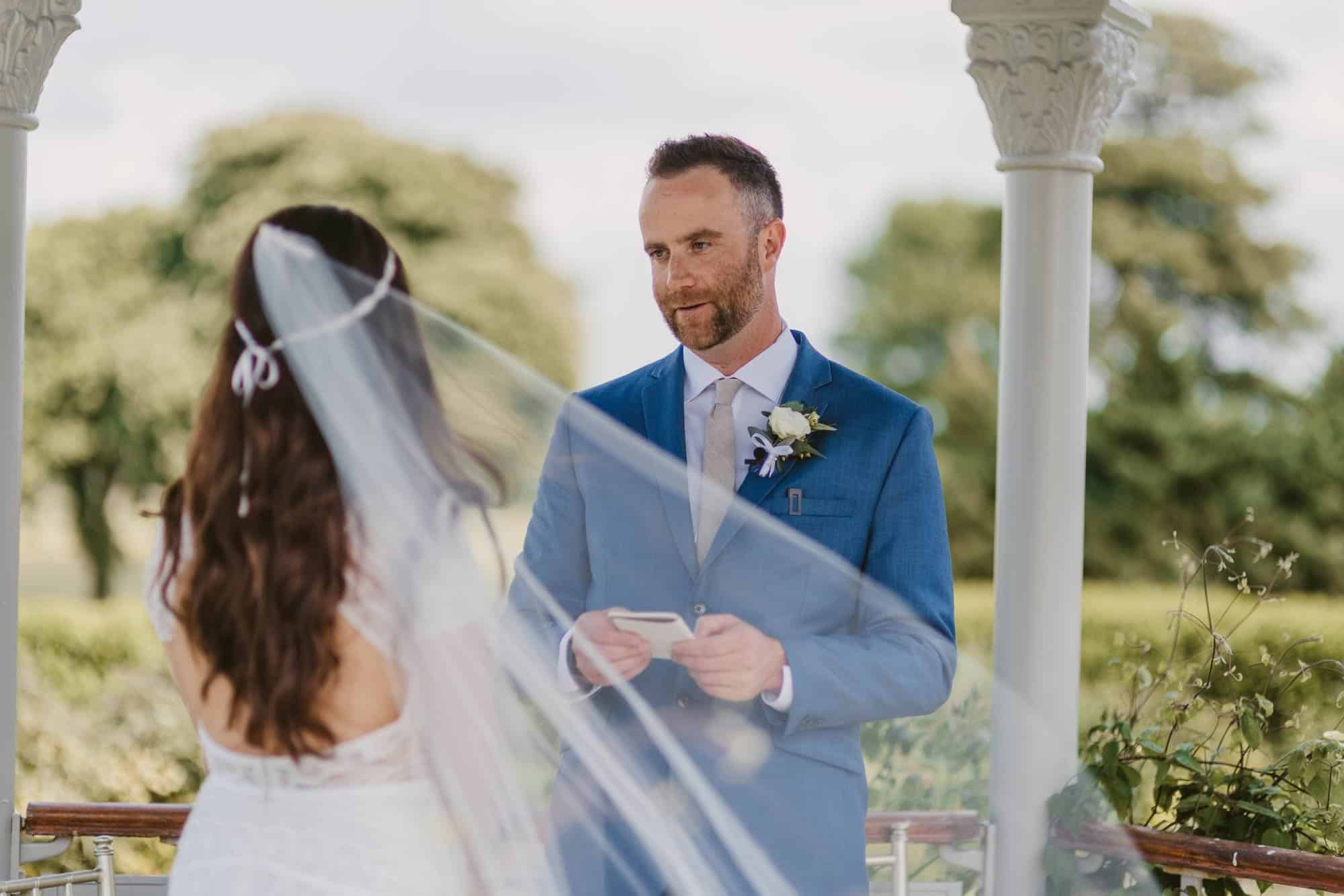 Elopement videographer Ireland, groom reading vows