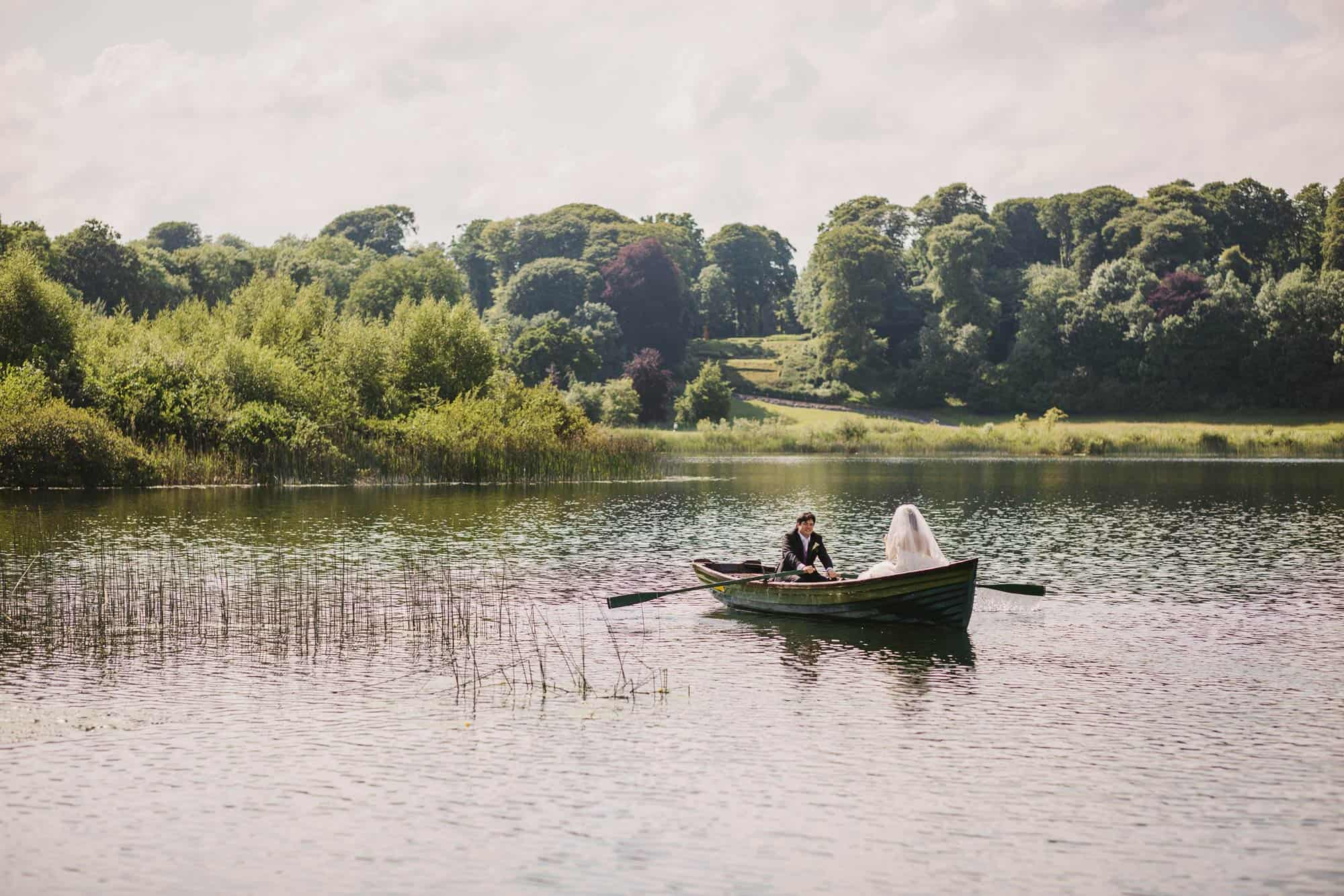 Dromoland Castle Ireland, couple rowing back on boat