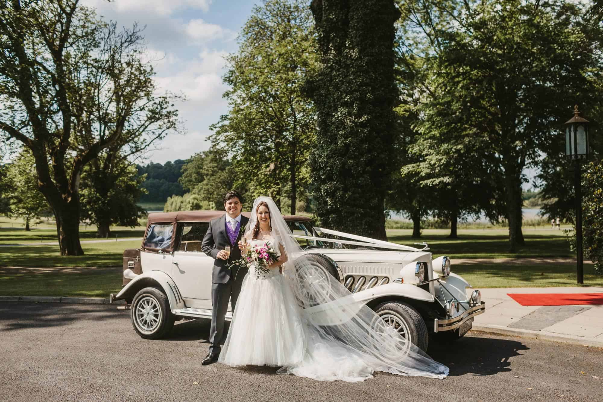 Dromoland Castle Ireland, couple in front of vintage car