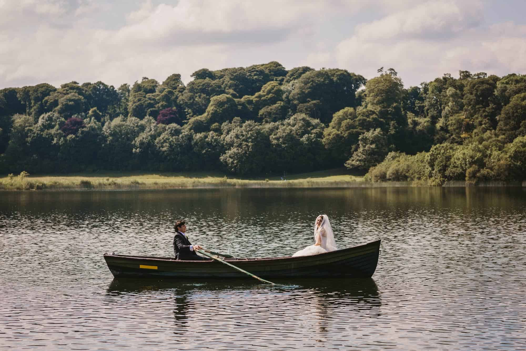 Dromoland Castle Ireland, couple out on lake on boat in sun