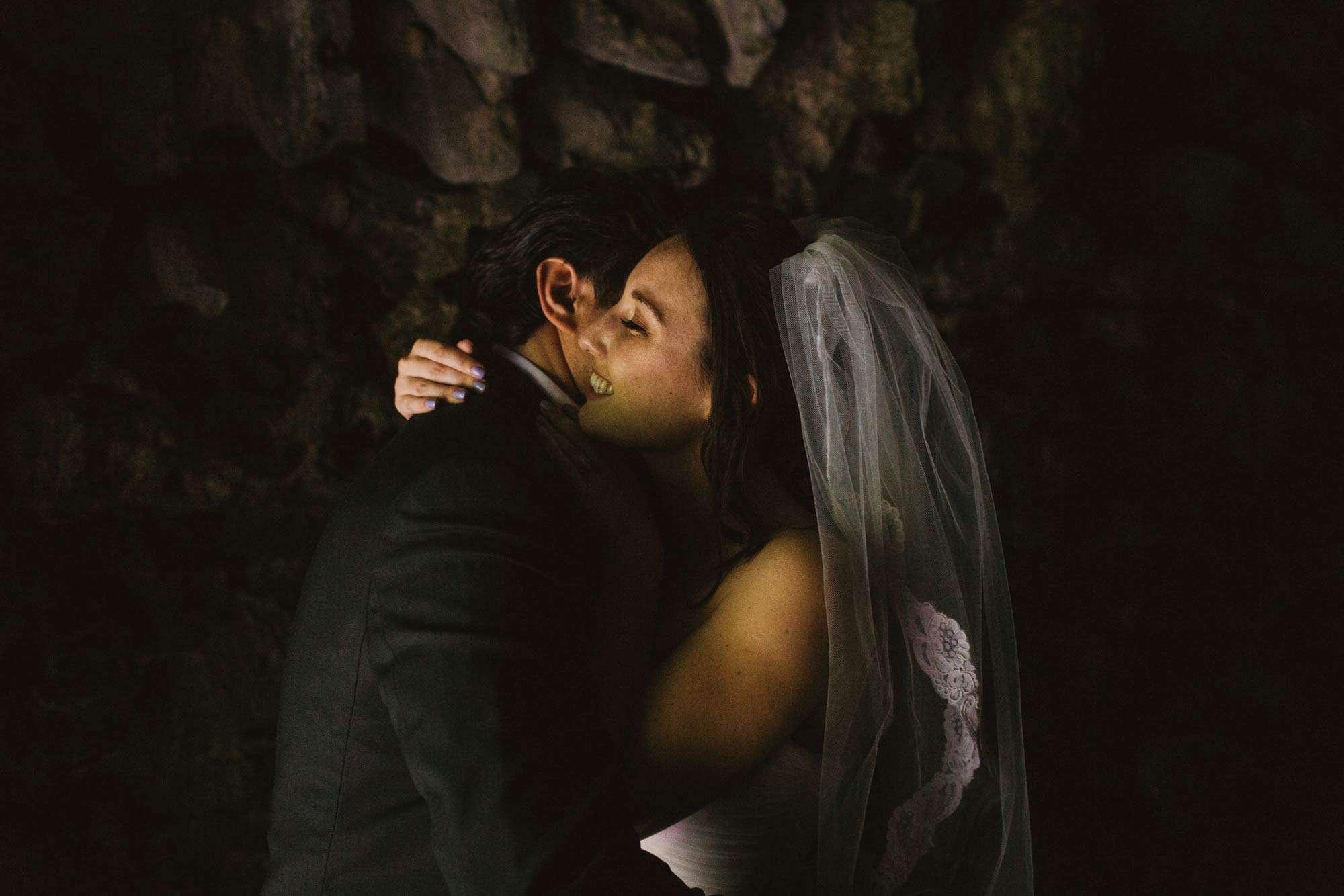 couple hug in low light