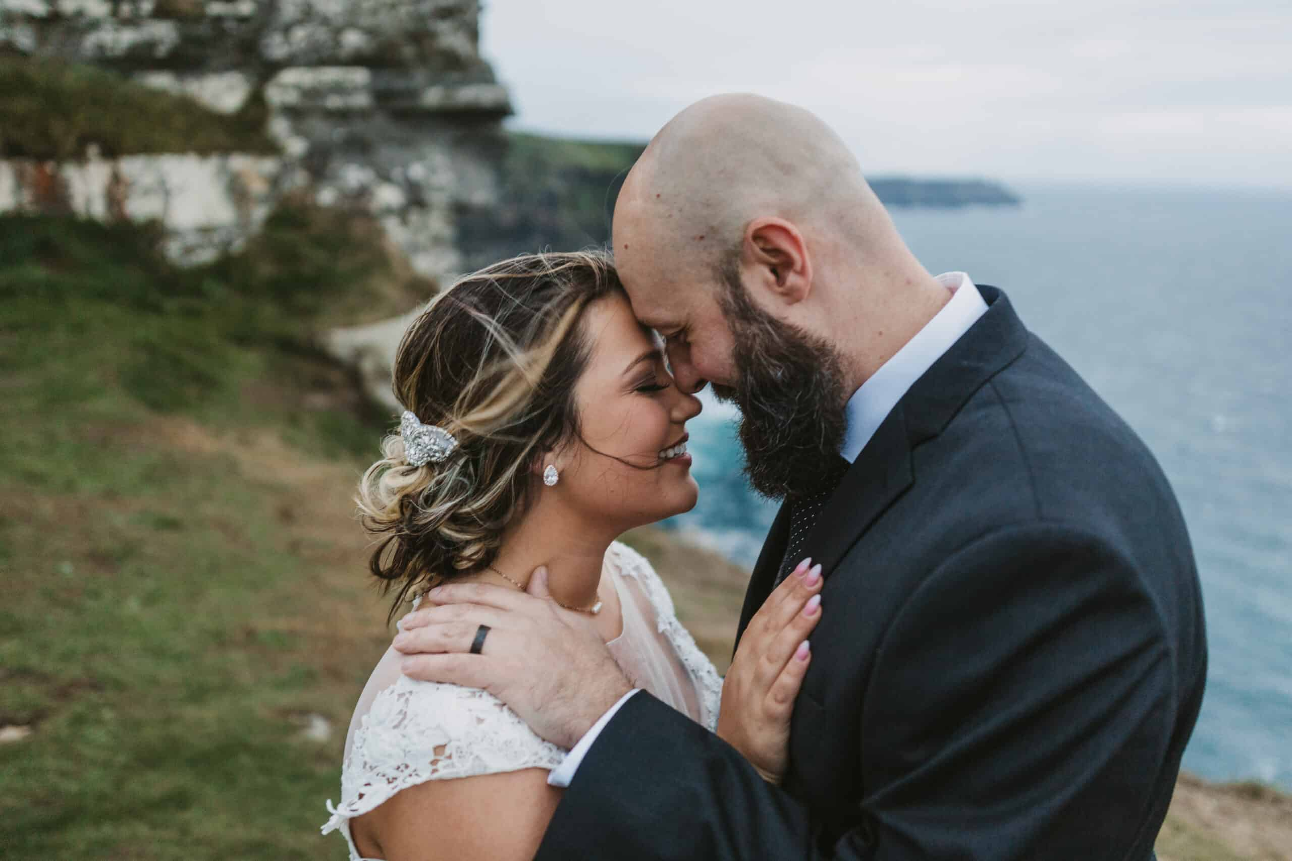 Cliffs of Moher Wedding Hags head, bride and groom touch foreheads