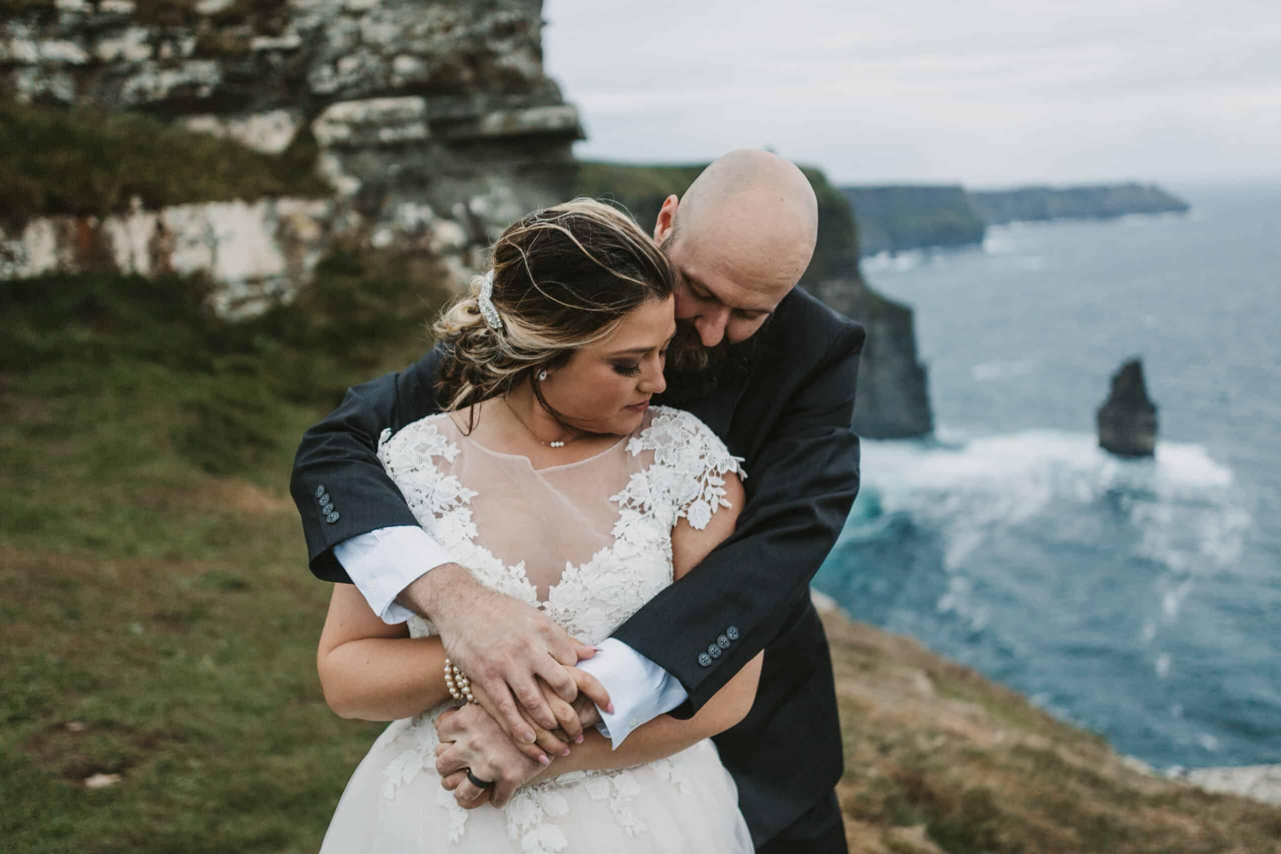 Cliffs of Moher Wedding Hags head, groom puts arms around bride