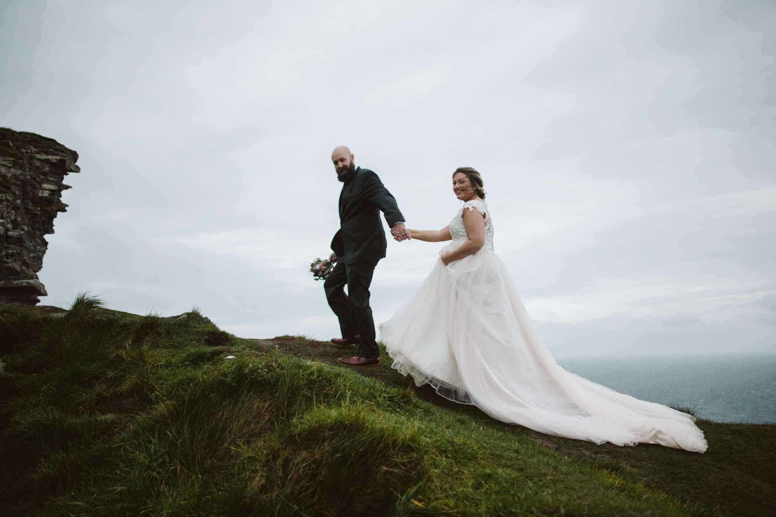 Cliffs of Moher Wedding Hags head, couple climb a hill