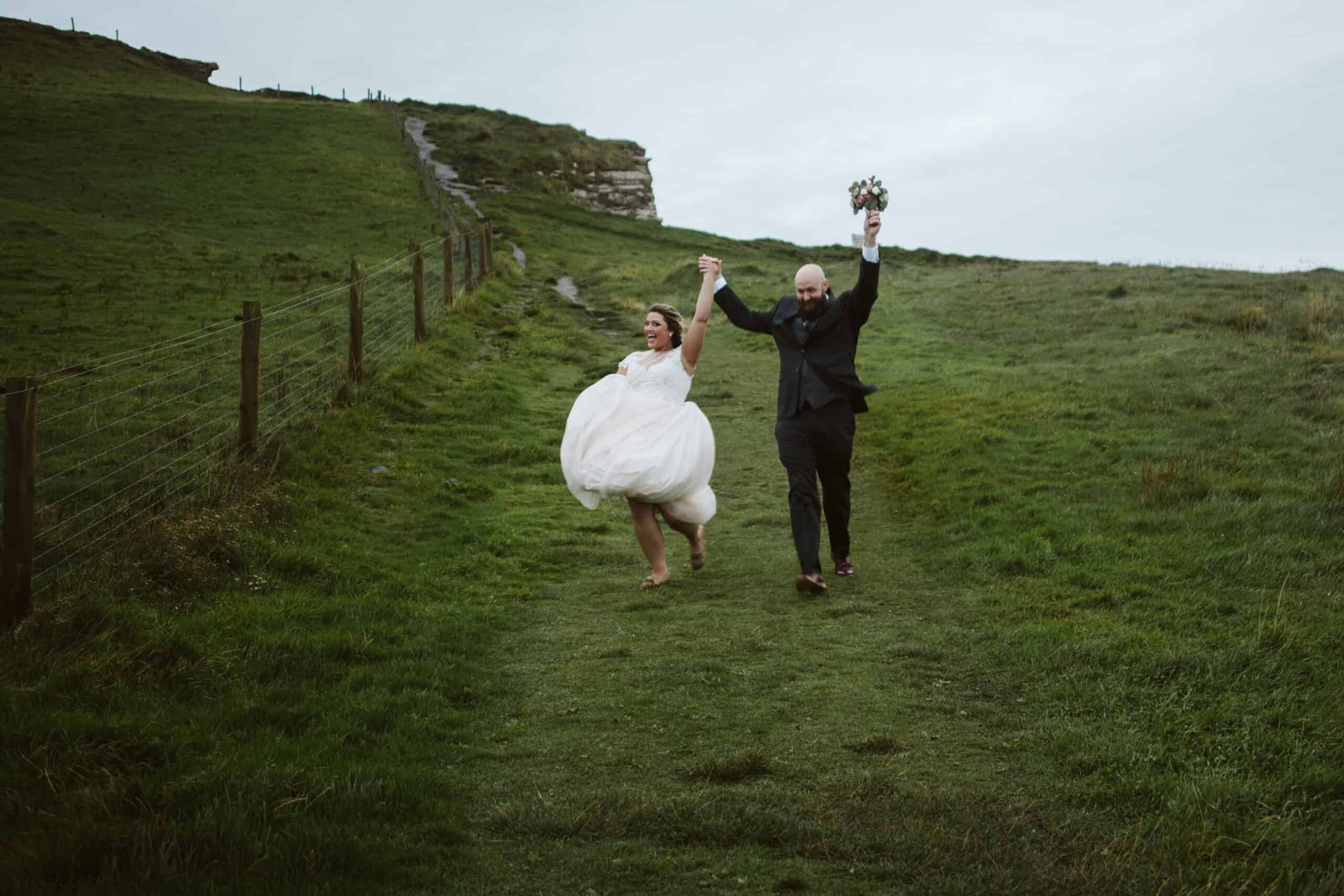 Cliffs of Moher Wedding Hags head, couple cheer and run down the hill