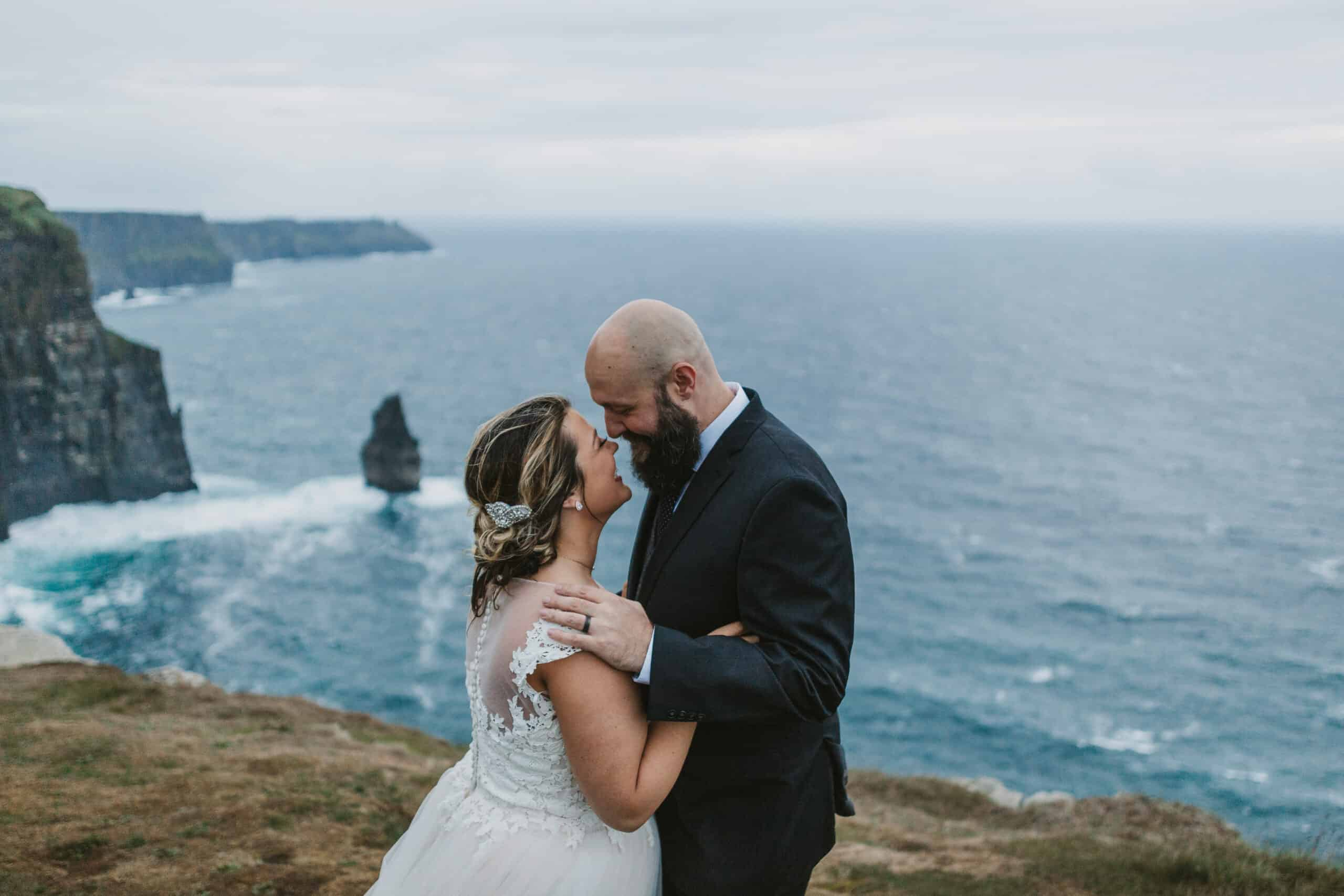 Cliffs of Moher Wedding Hags head, couple touch noses on the cliffs