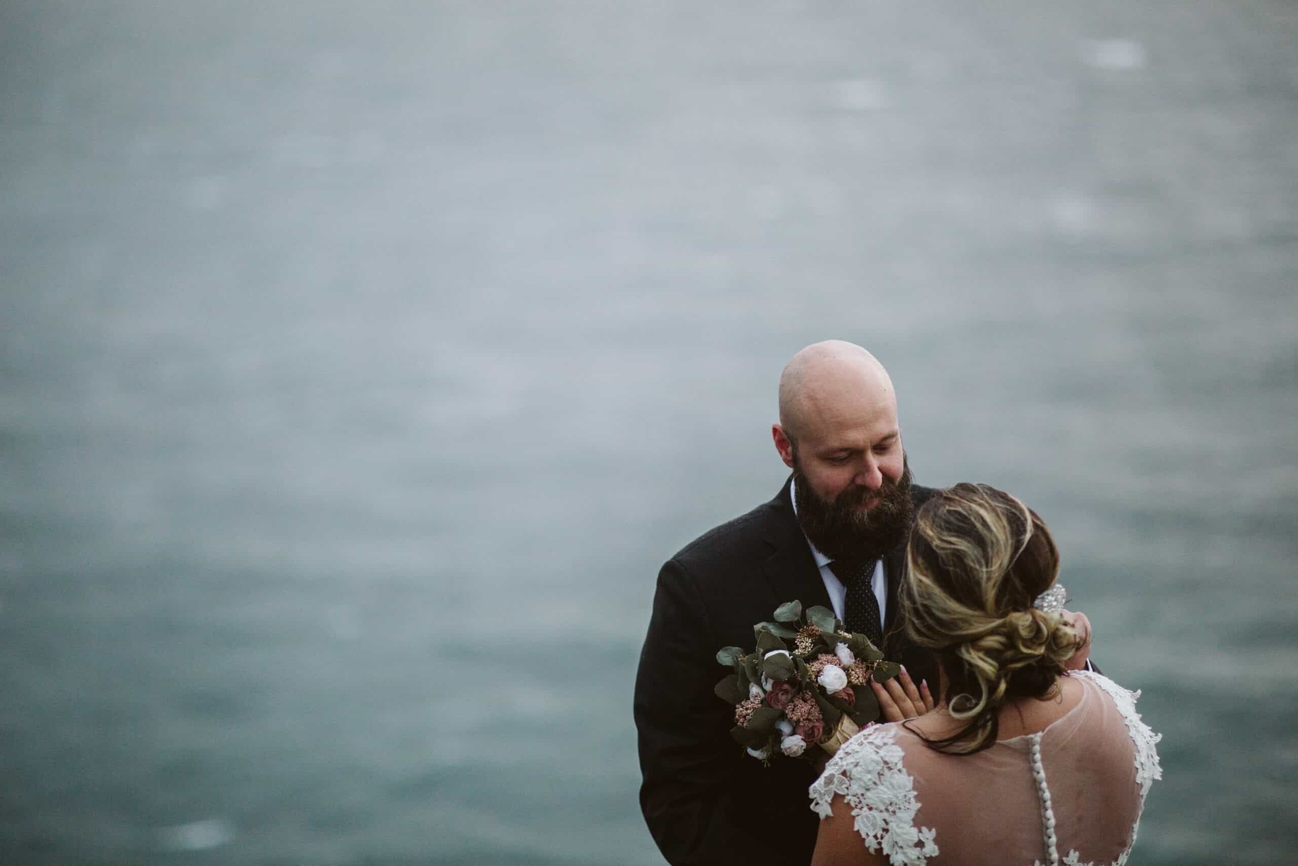 Cliffs of Moher Wedding Hags head, sea in background as couple chat