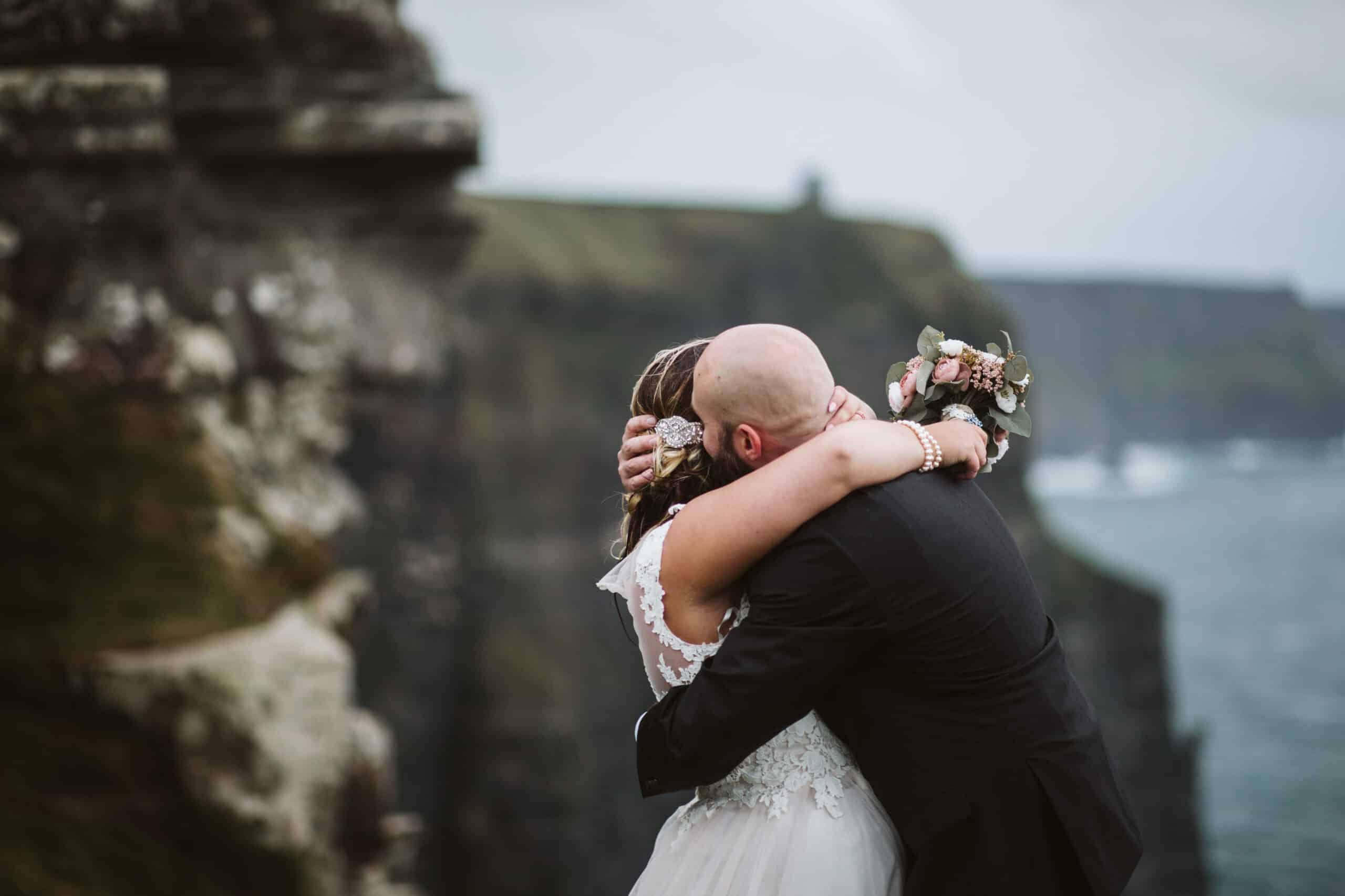 Cliffs of Moher Wedding Hags head, bride and groom hug