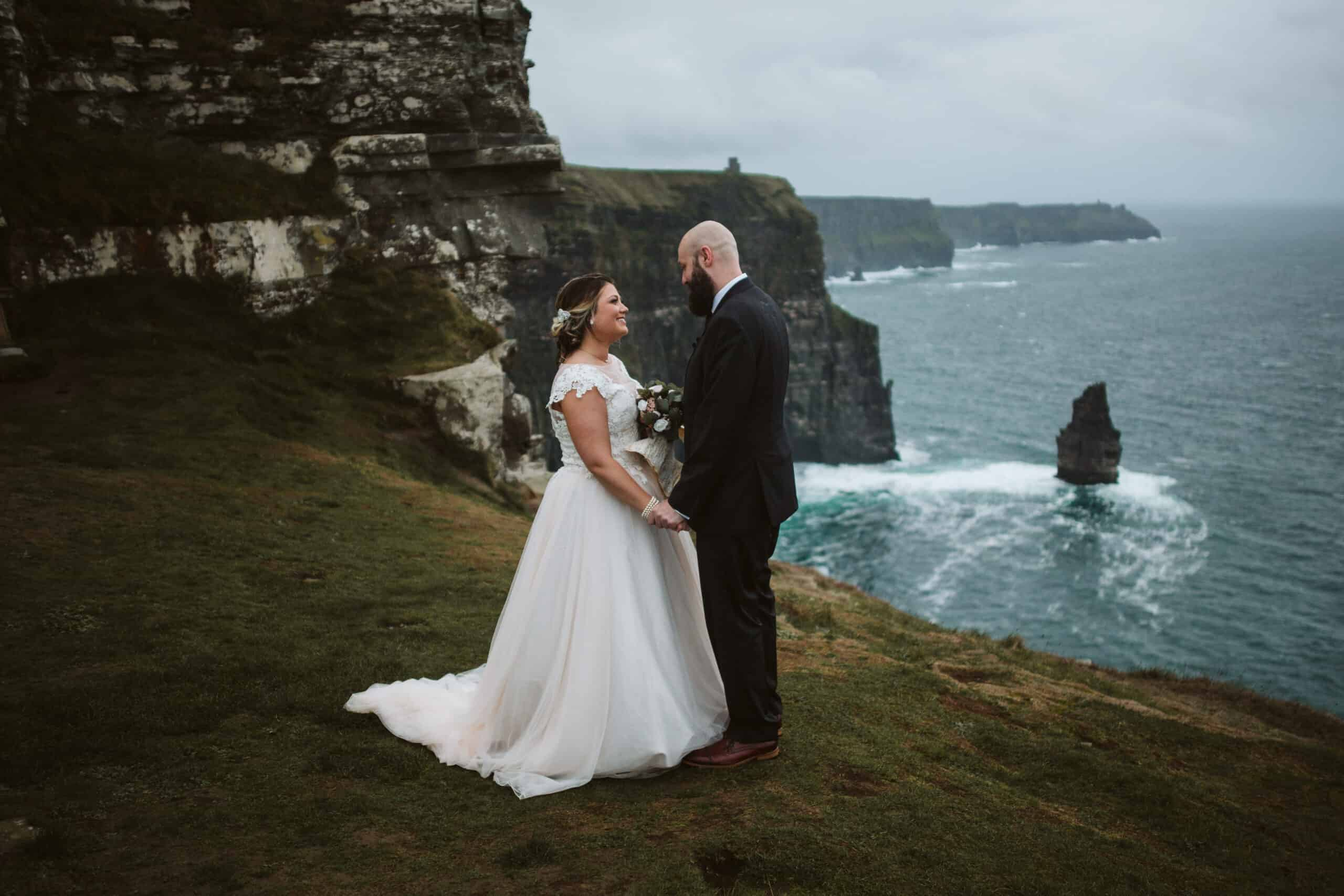 Cliffs of Moher Wedding Hags head, bride and groom holding hands on the cliffs