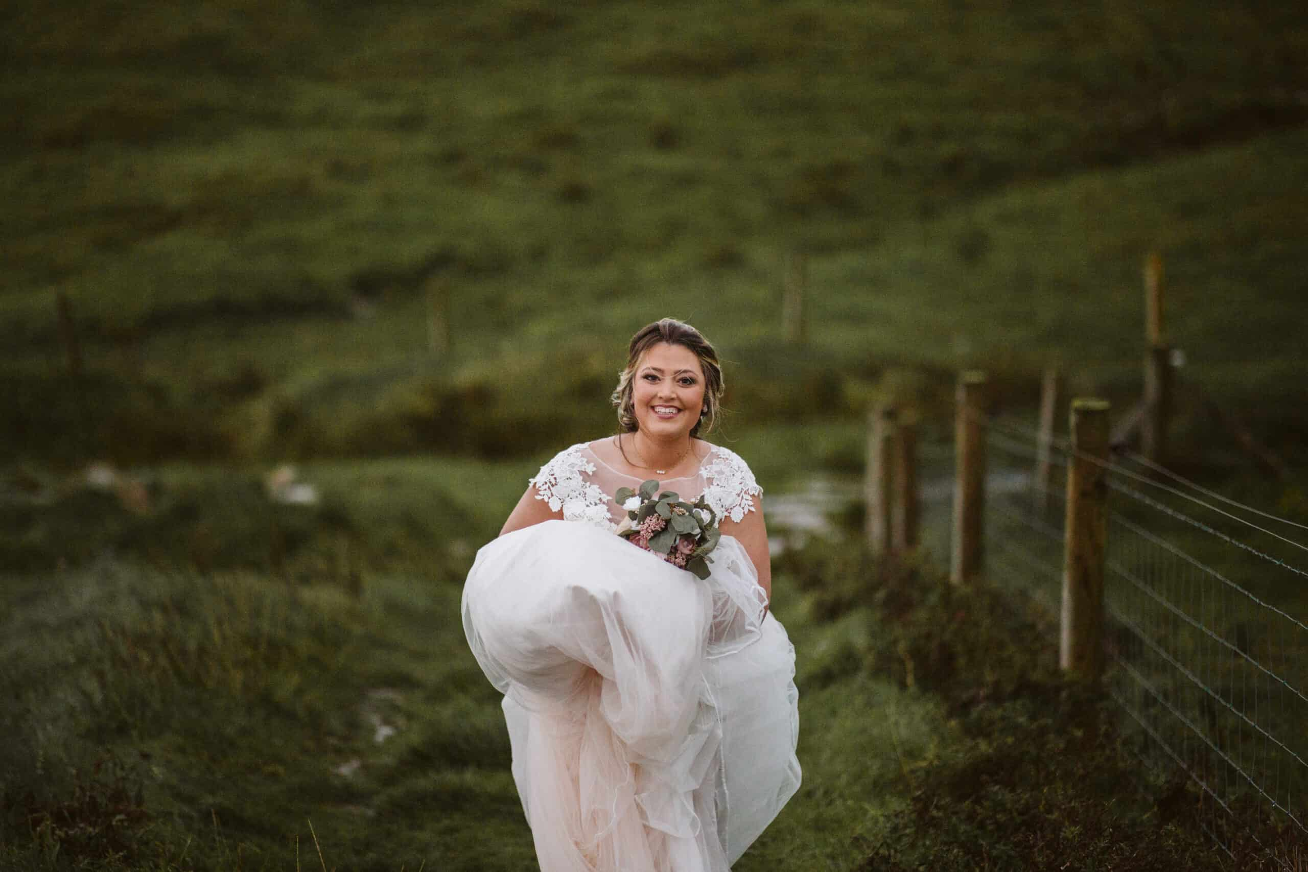 Cliffs of Moher Wedding Hags head, bride laughing as she walks