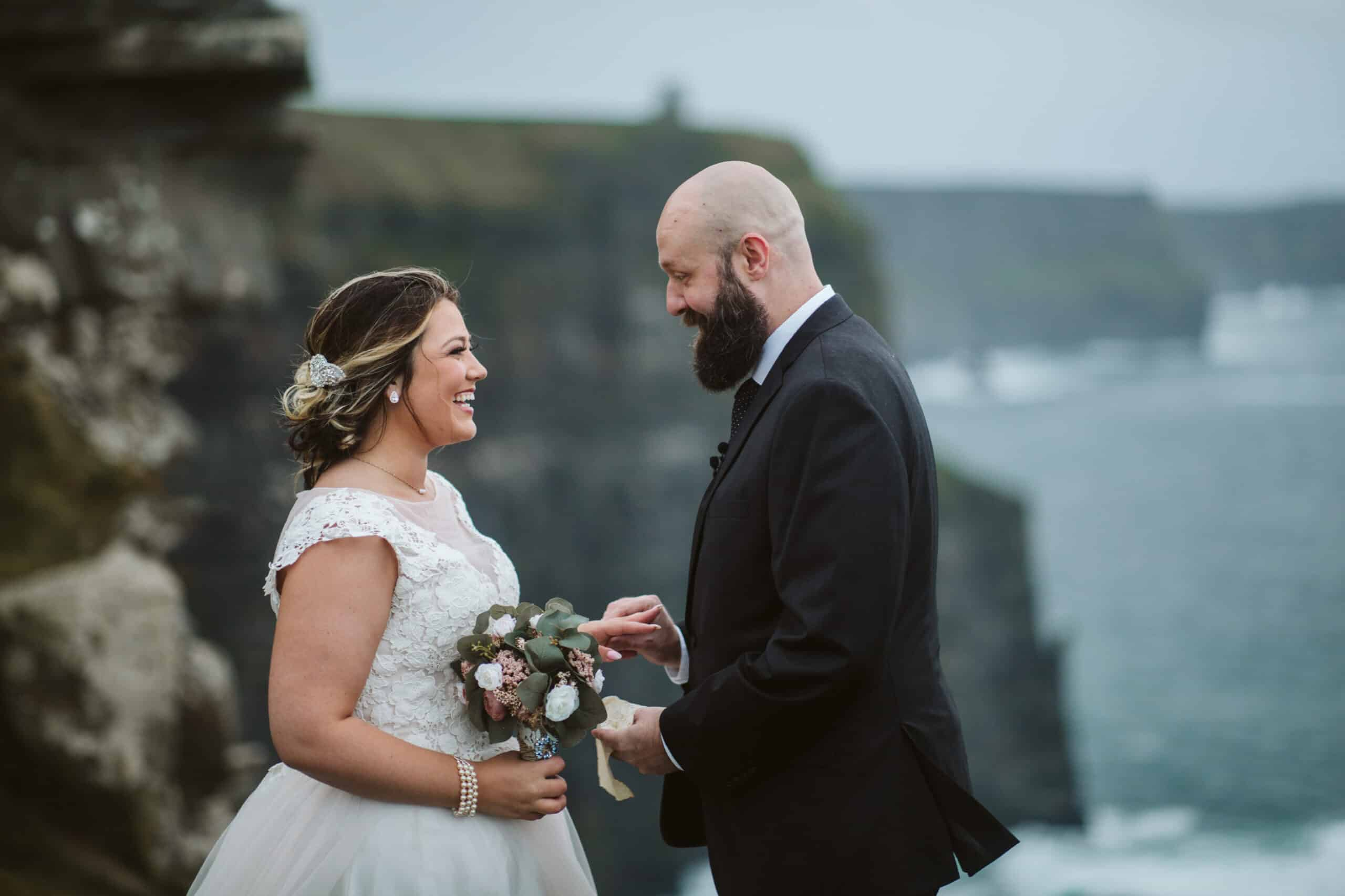 Cliffs of Moher Wedding Hags head, groom puts ring on brides finger