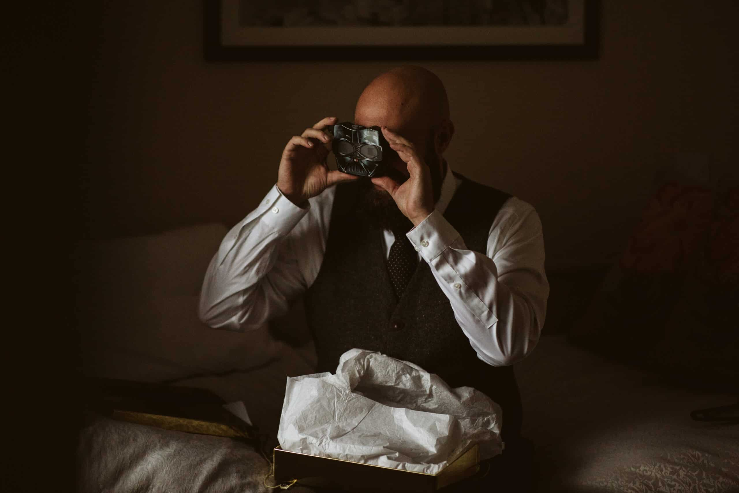 Cliffs of Moher Wedding Hags head, groom looking at gift, an old style projector