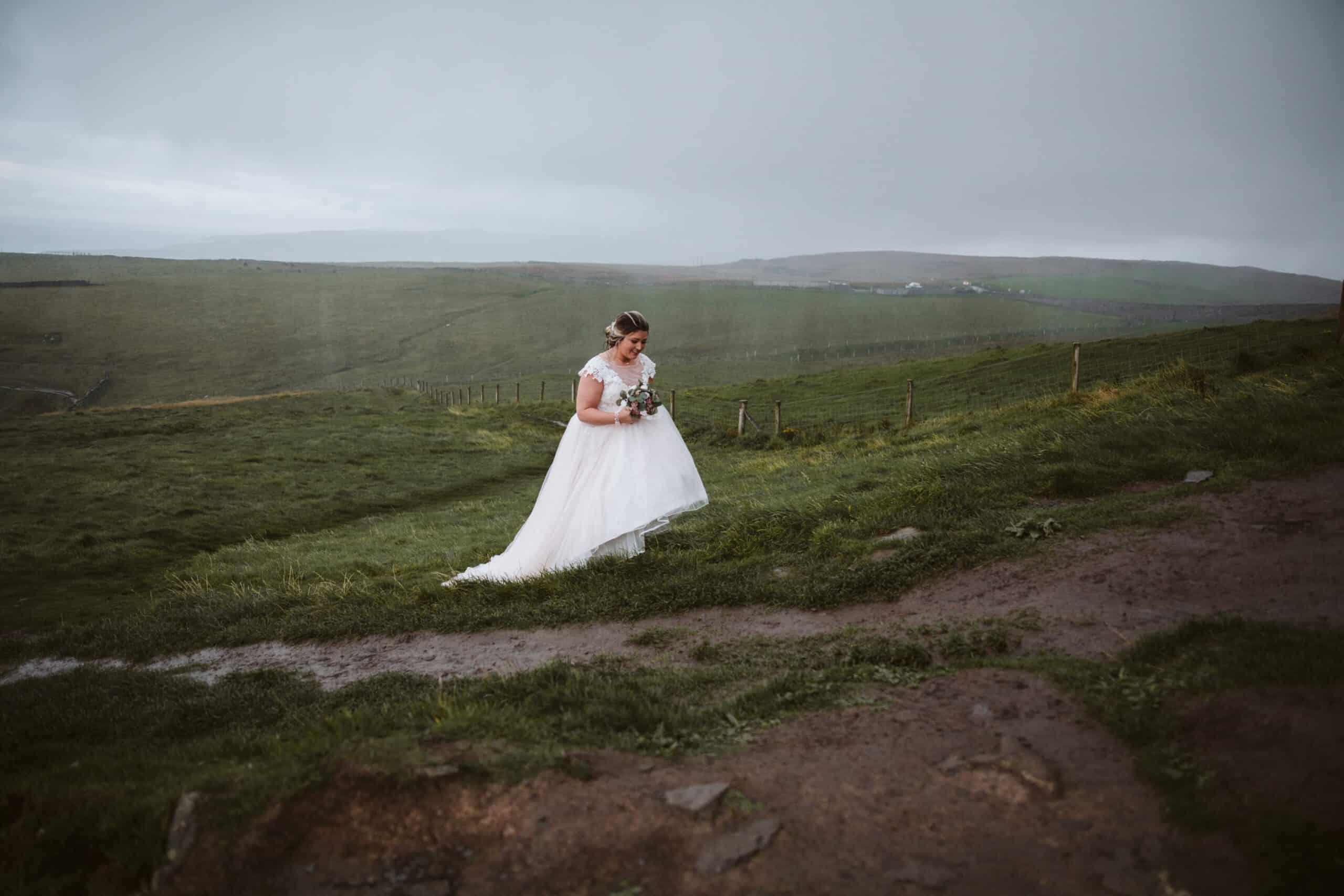 Cliffs of Moher Wedding Hags head, bride climbing a hill in dress