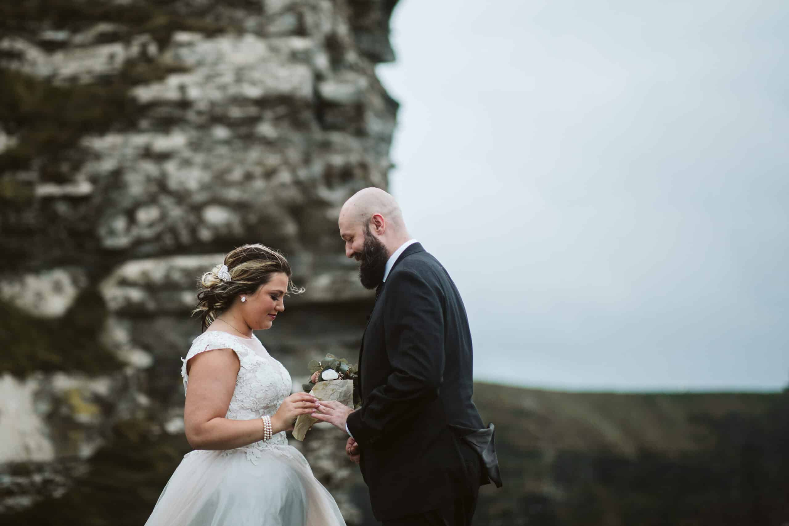 Cliffs of Moher Wedding Hags head, bride puts ring on grooms finger