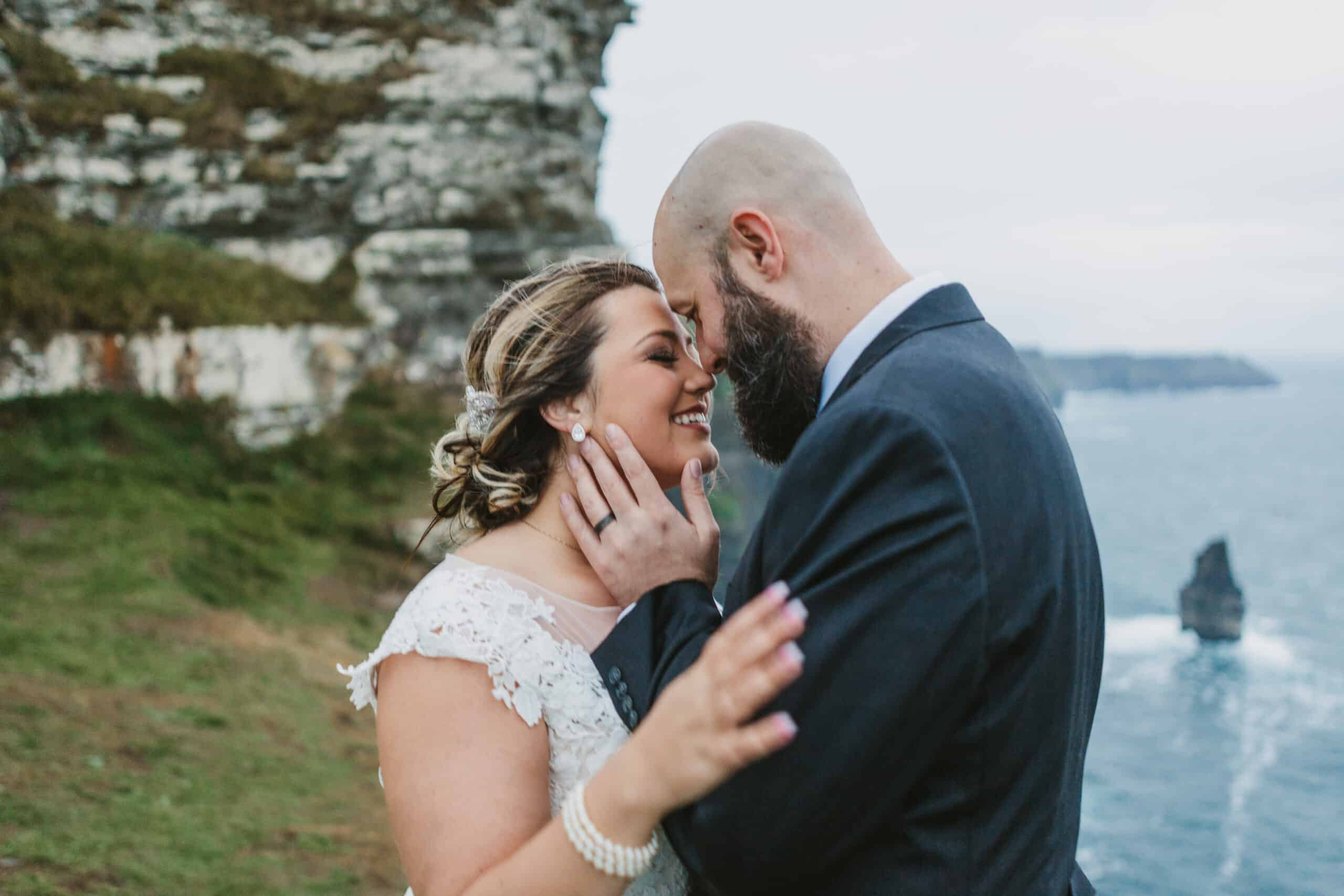 Cliffs of Moher Wedding Hags head, grooms hand on brides face