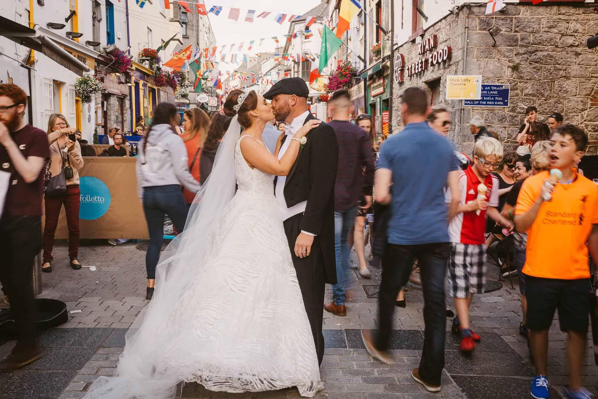 Wedding photography Ireland Kiss on the streets