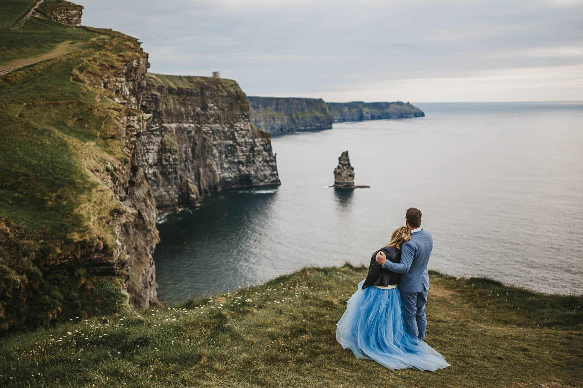 Cliffs of Moher elopement, A couple stand on the cliffs looking out to see after the decided yes, they should elope