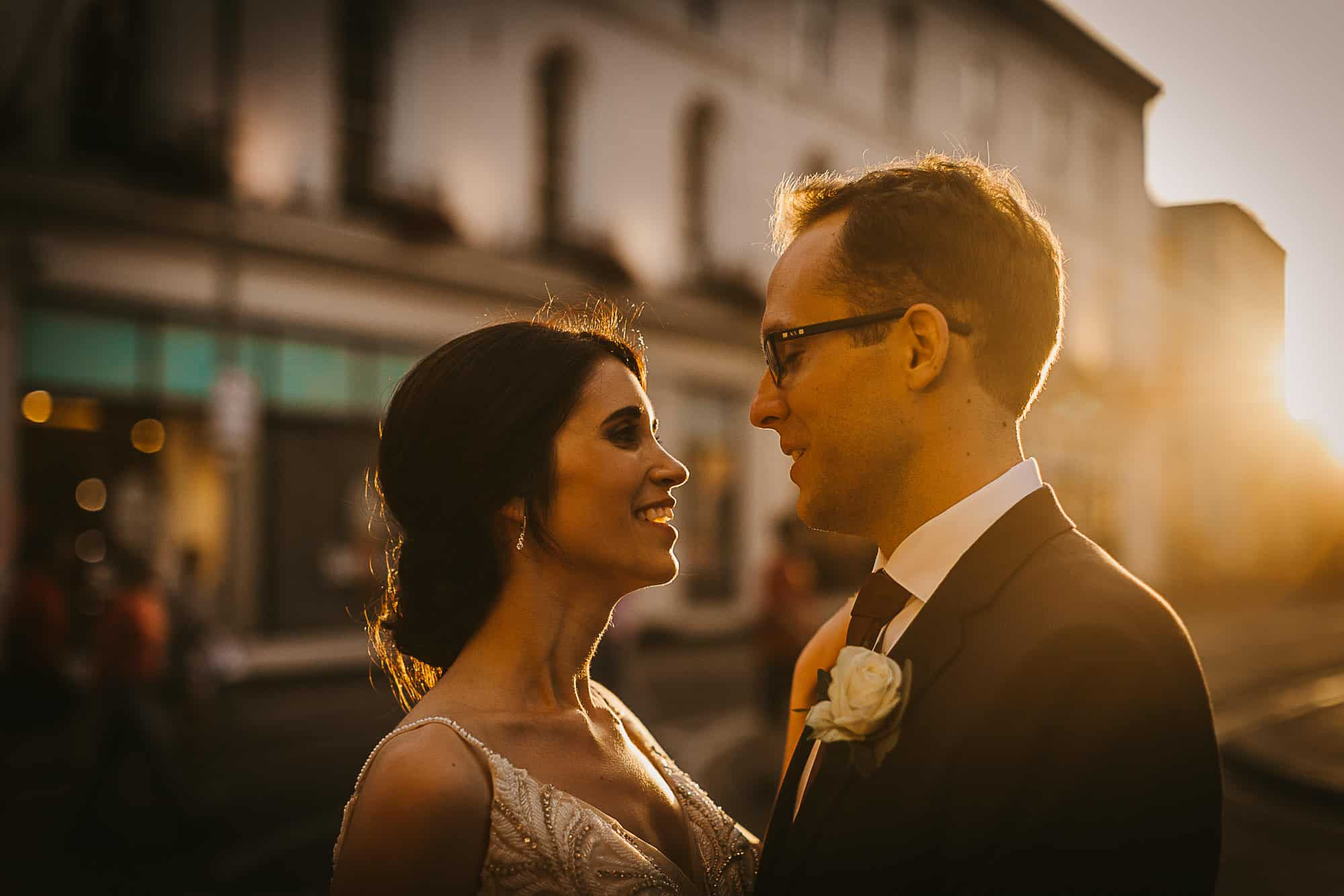 Galway City Elopement Fun, A COULPE AT SUNSET on the streets of Galway arranged by their wedding planner in Ireland