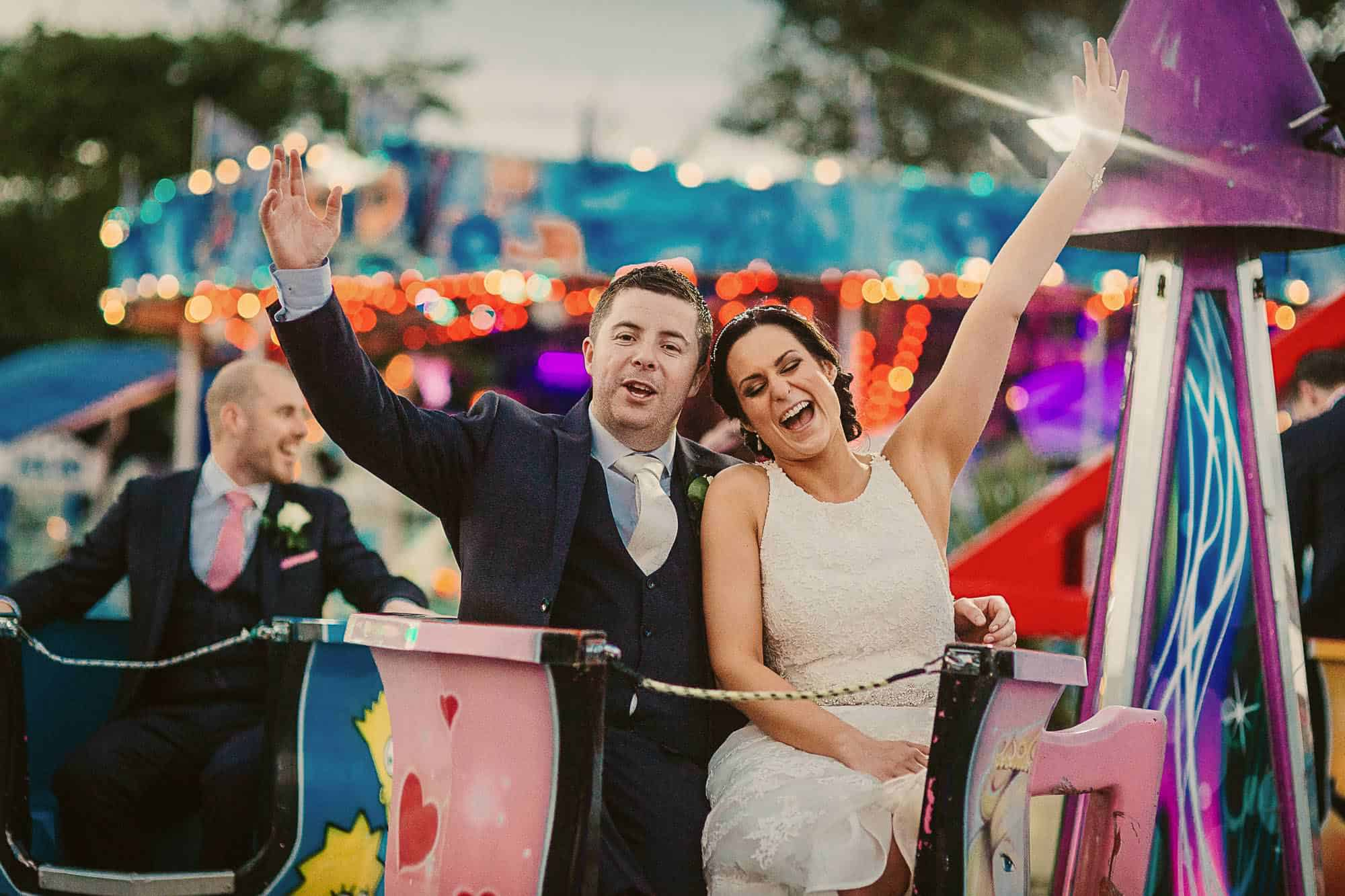 Galway City Elopement Fun, a couple on teacups at a fair ground on their Destination Wedding in Ireland