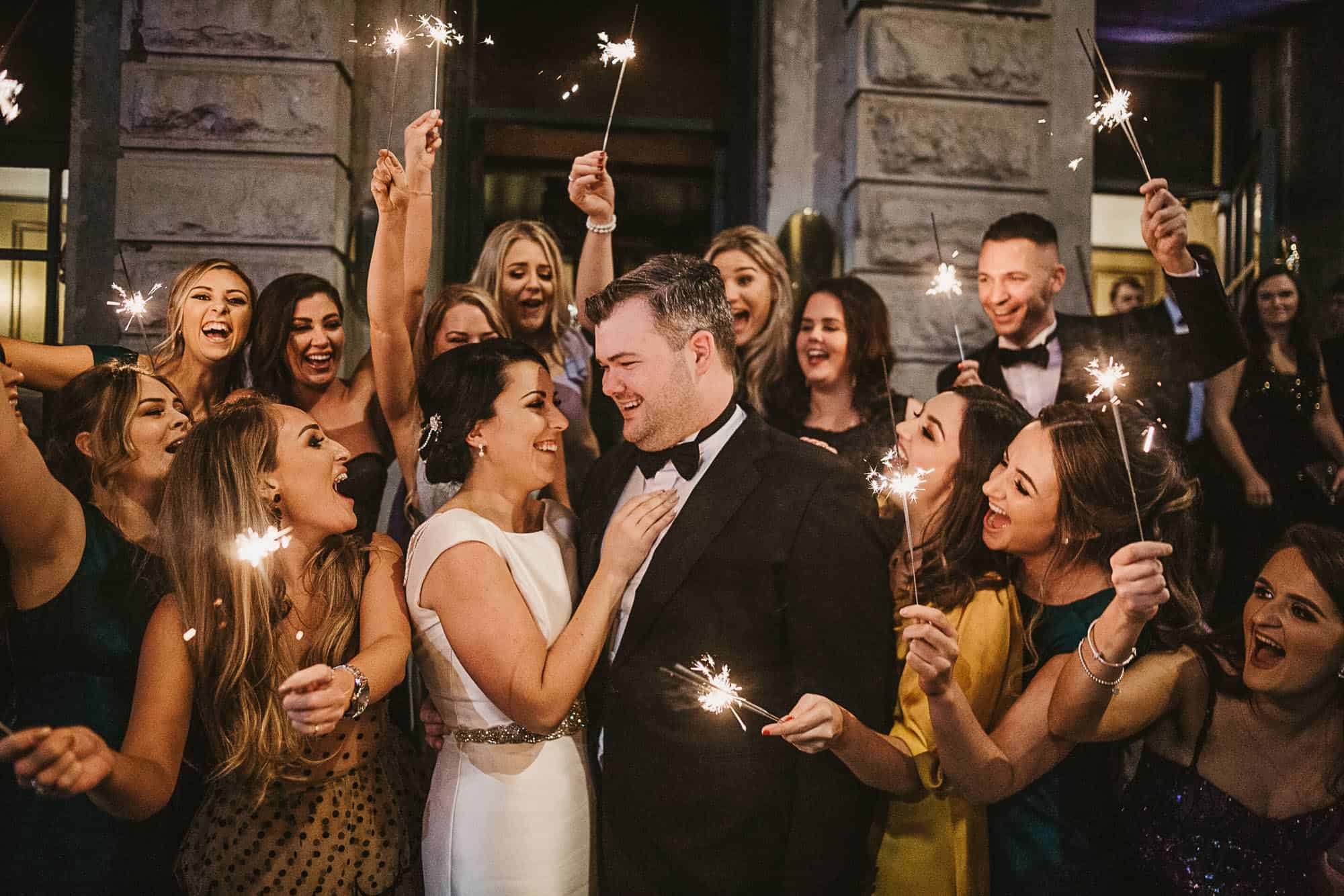 Galway city elopement with Twin flames, a party crown celebrating their day after deciding yes the  we should elope